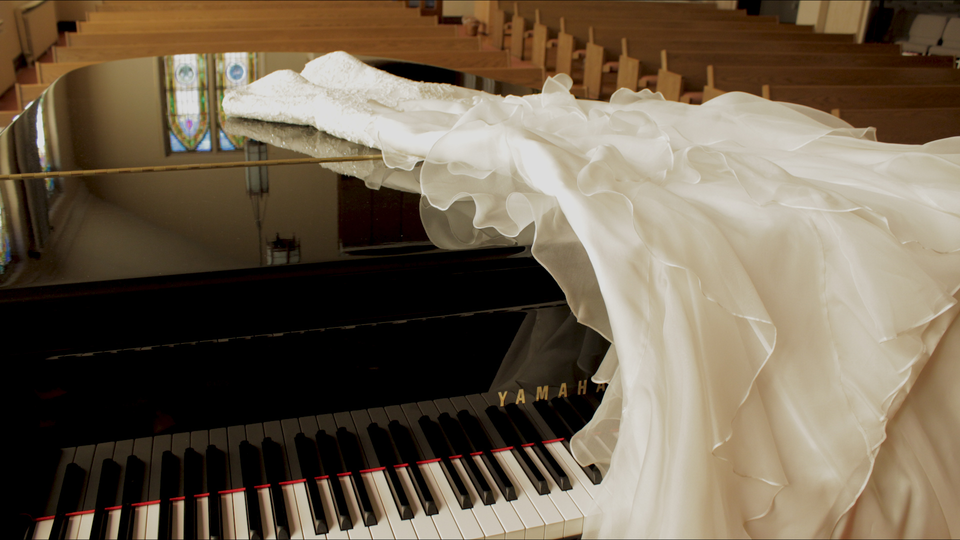 Wedding dress on piano.jpg