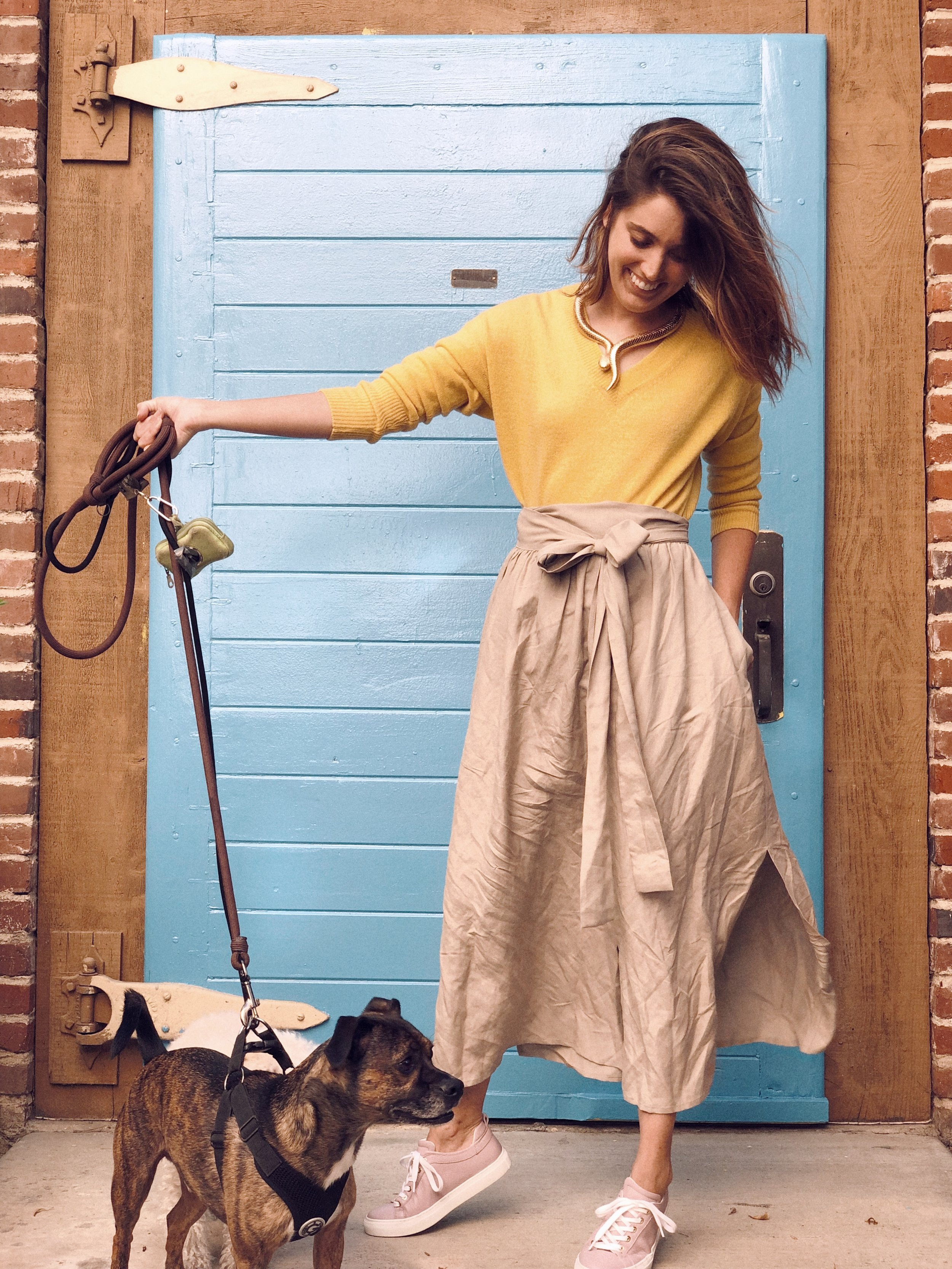 Sweater- Cuyana; Skirt- Ozma of California; Sneakers- M. Gemi; Dog appearance by Yogi