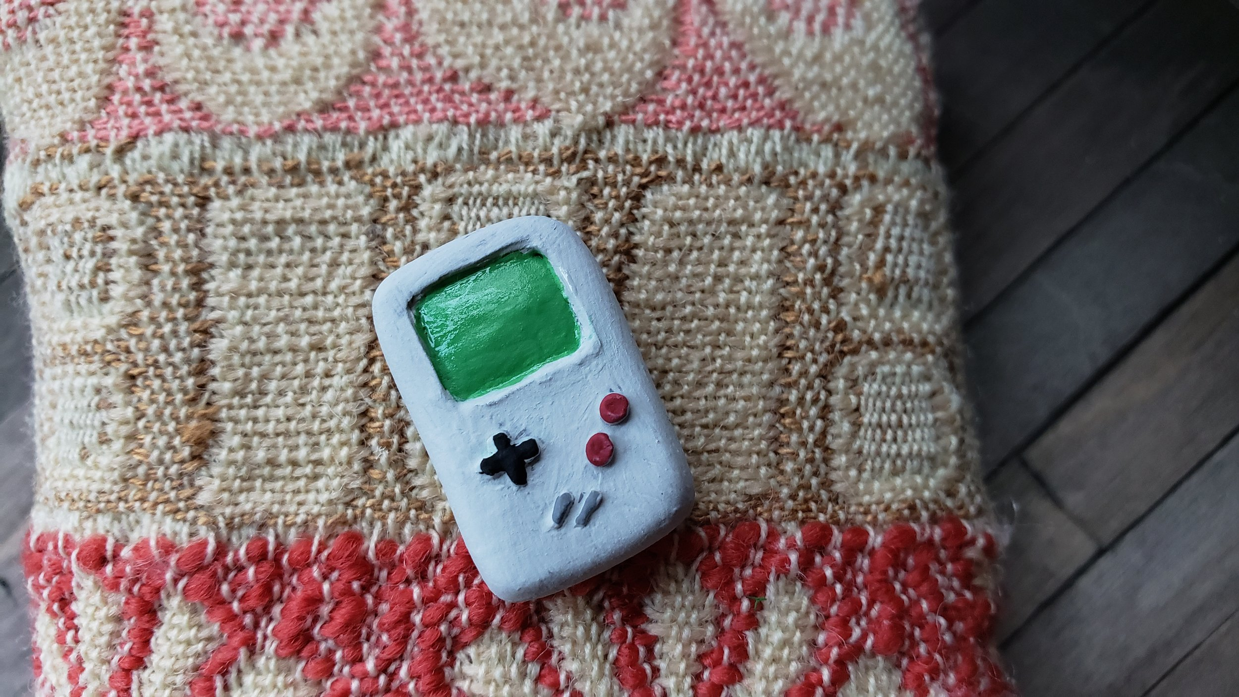 Miniature Prop - used a gameboy for reference   Materials: polymer clay, painted with acrylic paint