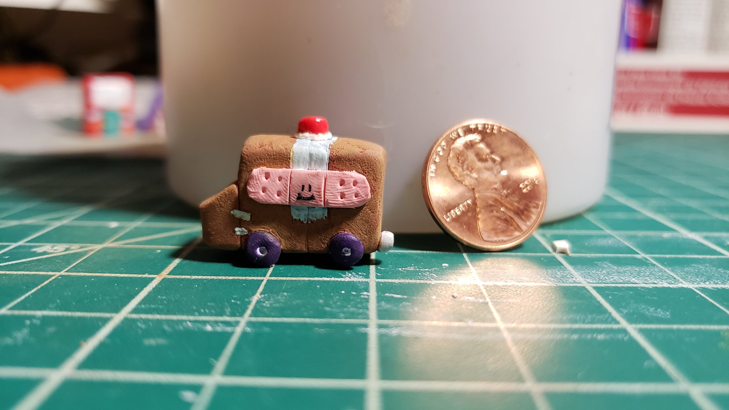 Based on my cardboard box ambulance drawing.  Materials: polymer clay, chalk pastel, acrylic paint