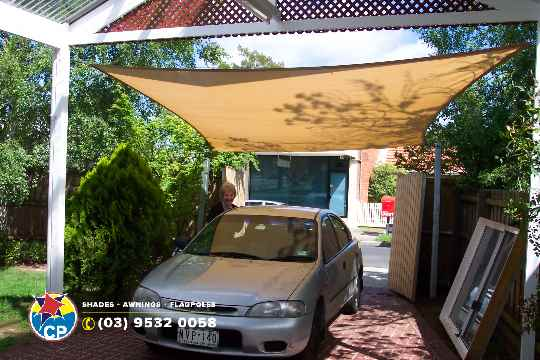 Shade carport greycar.jpg