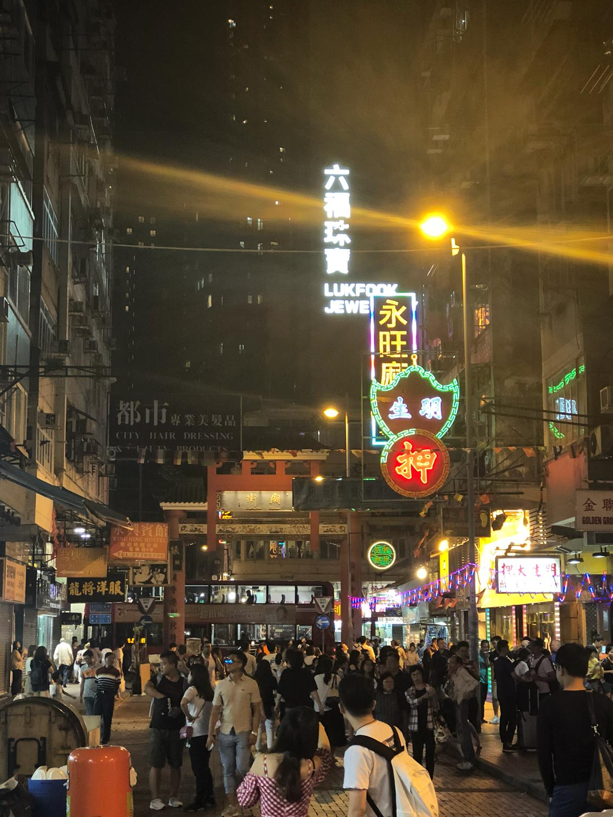 Nighttime in Kowloon is lively. Shops and restaurants are packed, and everyone is out enjoying themselves.
