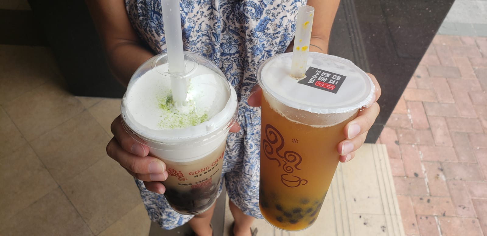 """""""Sakura Blossom"""" (still not sure what was in this drink, but it was unique), and a mango green tea with fresh mango chunks. Yum."""