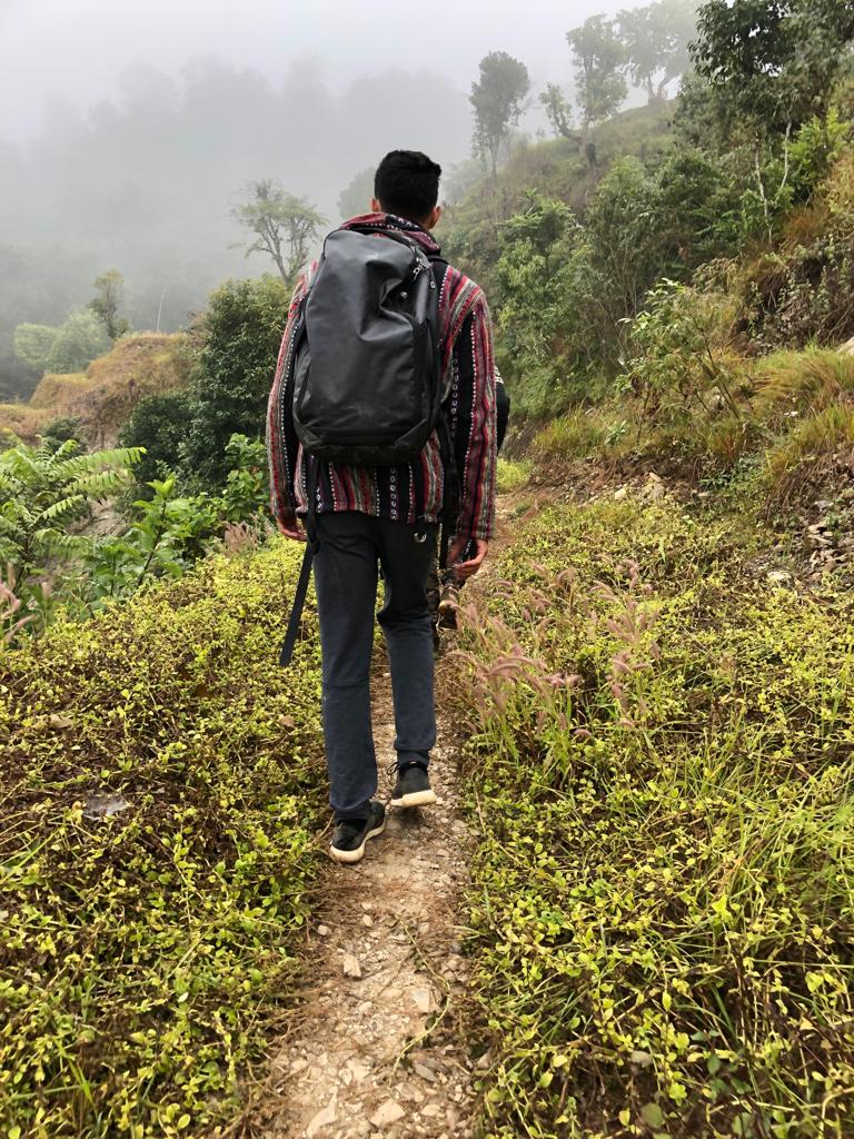 Trekking down the mountain.