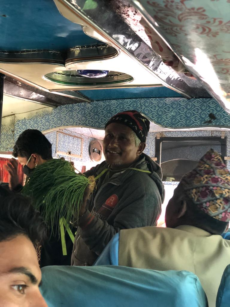 What's a bus ride in Nepal without an appearance from the onion man?