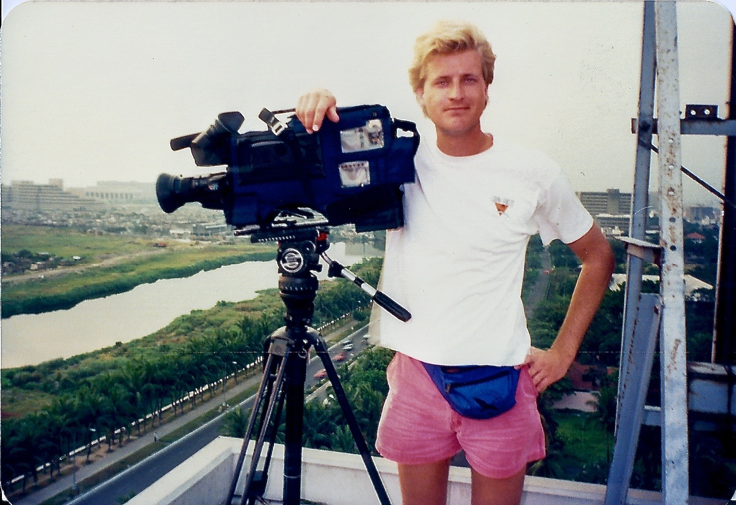 Shooting documentaries in Manila, Philippines while sporting then-in-fashion hot pants and fanny pack.