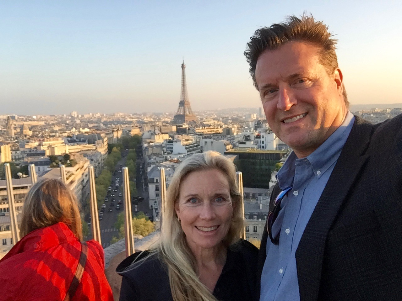 With bride on top of the Arc de Triomphe in Paris before consuming inordinate amounts of macarons and escargot, in that order.