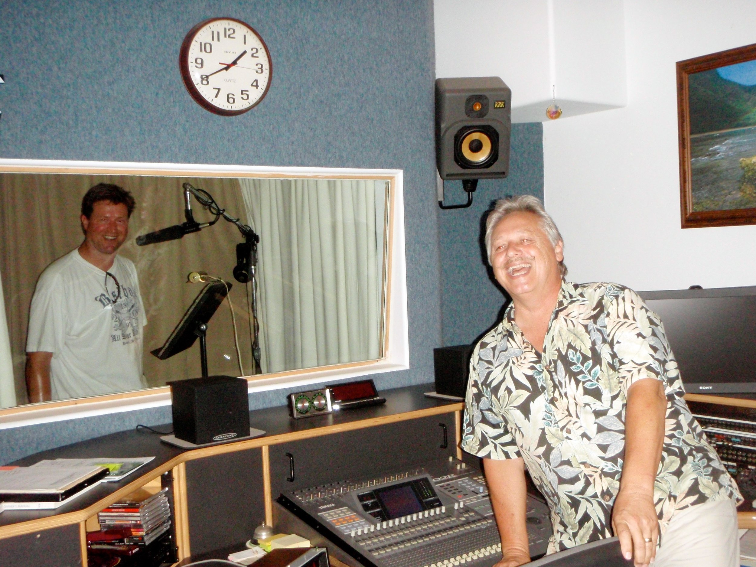 Sealed behind glass at the wonderful Audio Images recording studio with Davey Lou in Kauai.  Below frame, both men are wearing grass skirts.