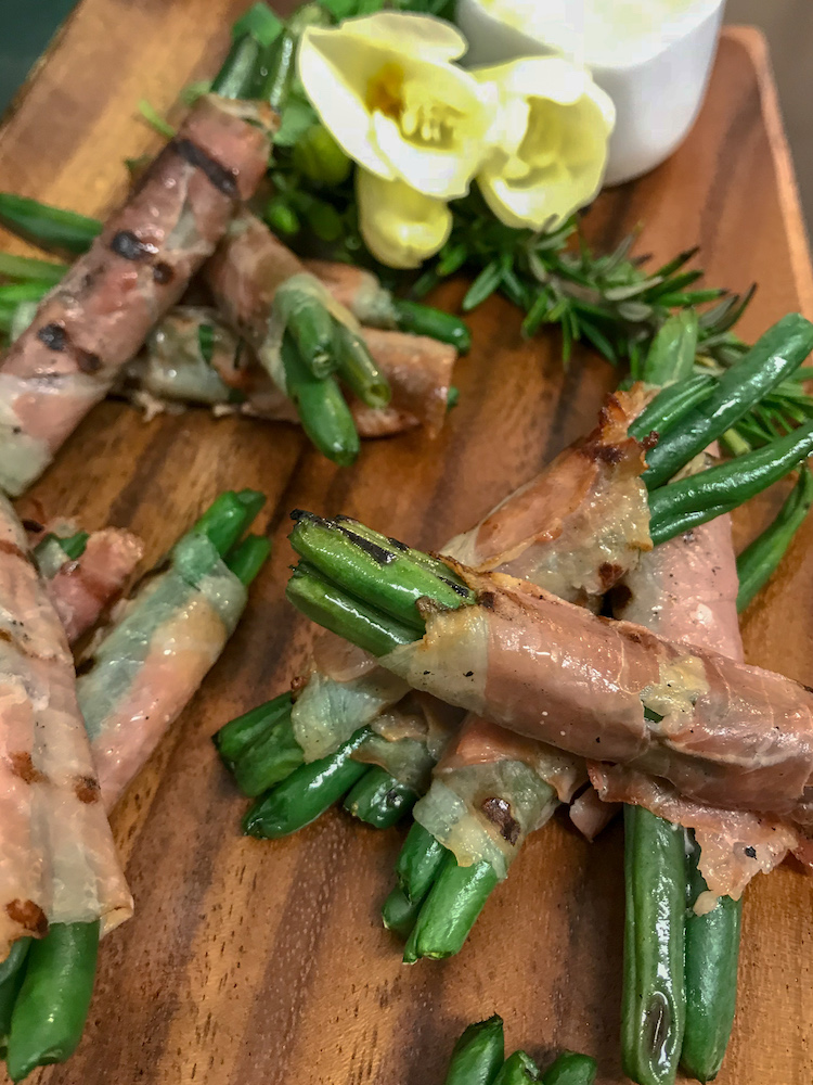 Grilled green beans wrapped in prosciutto with hollandaise GF