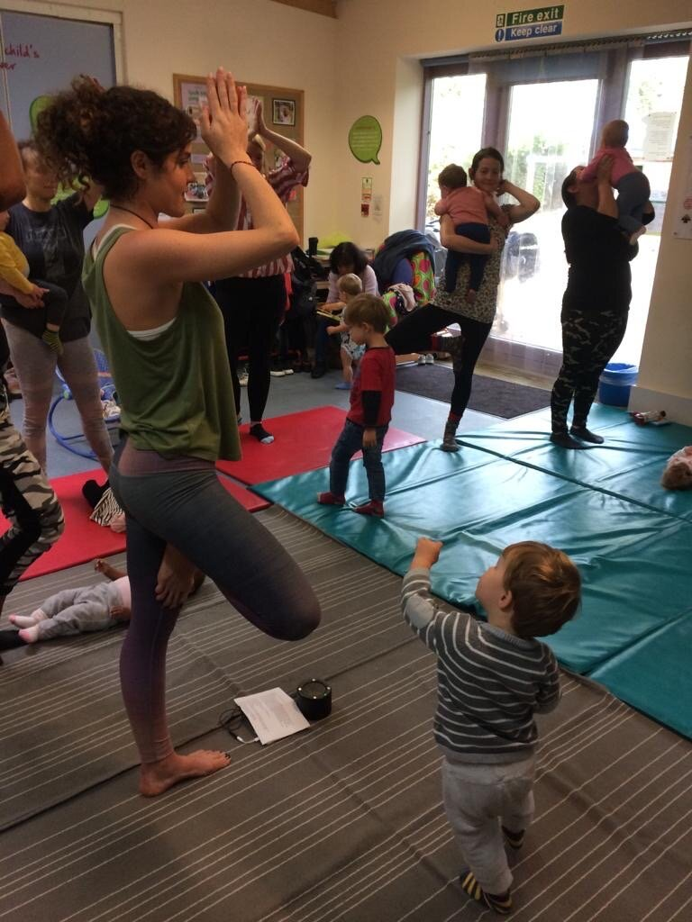 HERE Co-Founder Jen Armstrong leads yoga at Cathnor Park Children's Centre, Family Support