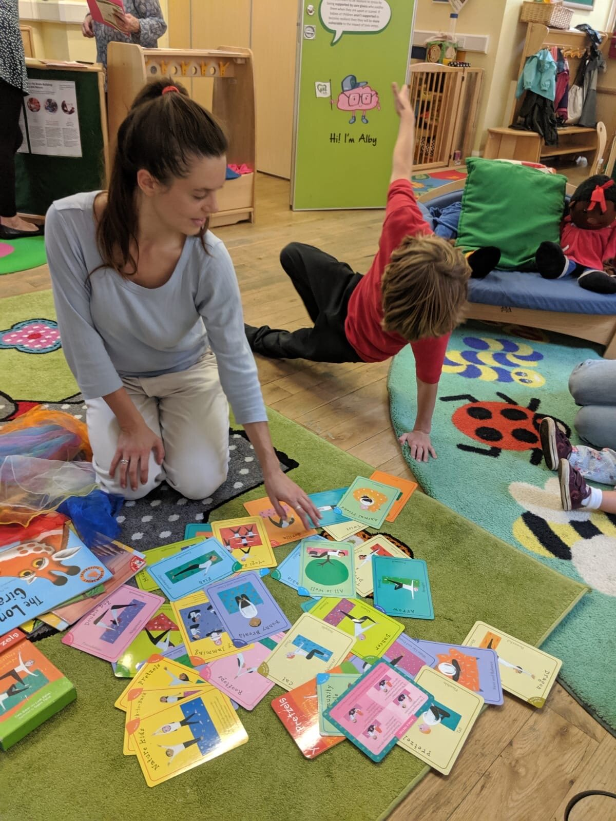HERE Om:Pop team member Aoife Baigent helps lead a session at Melcombe Children's Centre, Family Support