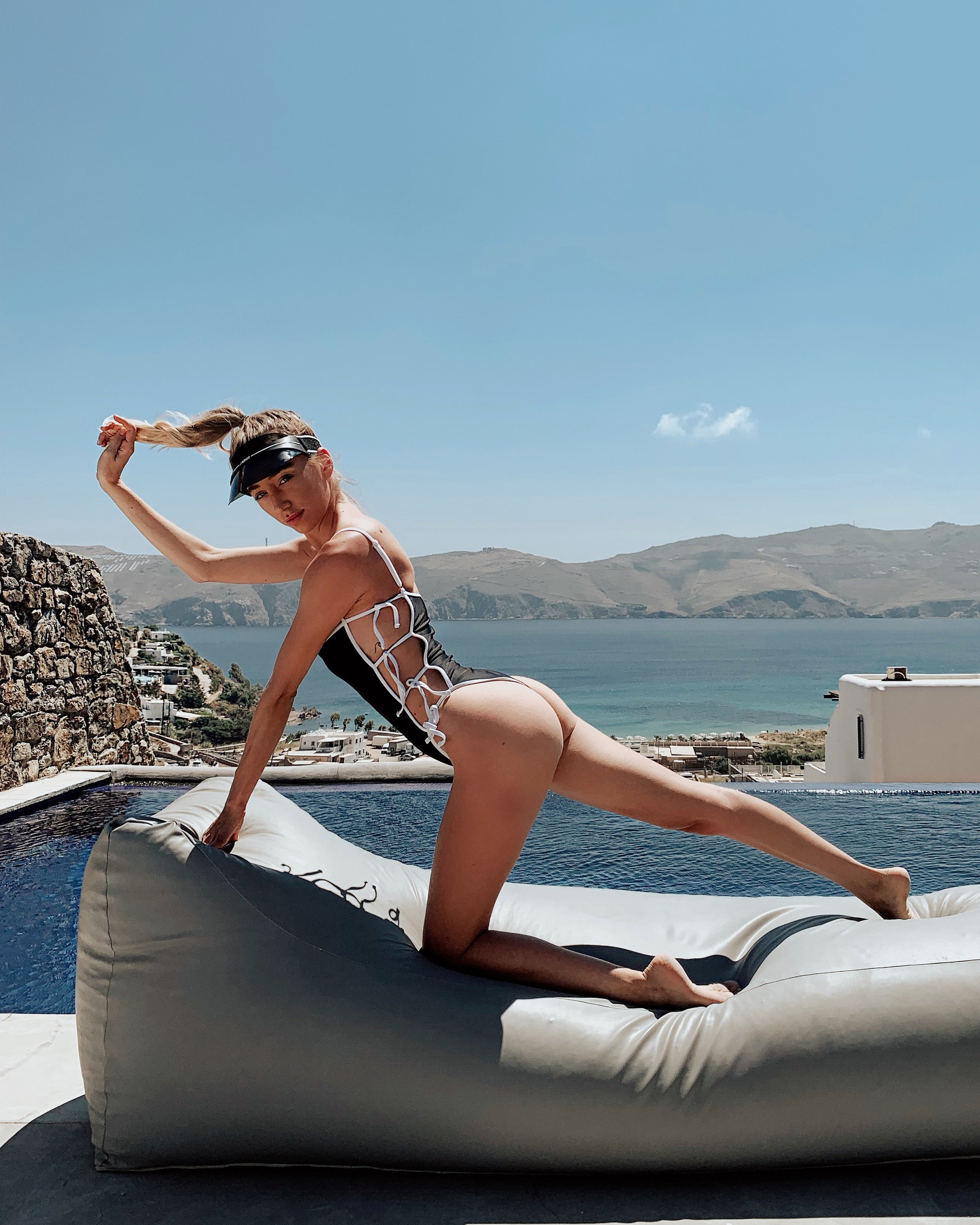 Also, here is me being XTRA in @gigicbikinis at our villa LOL.