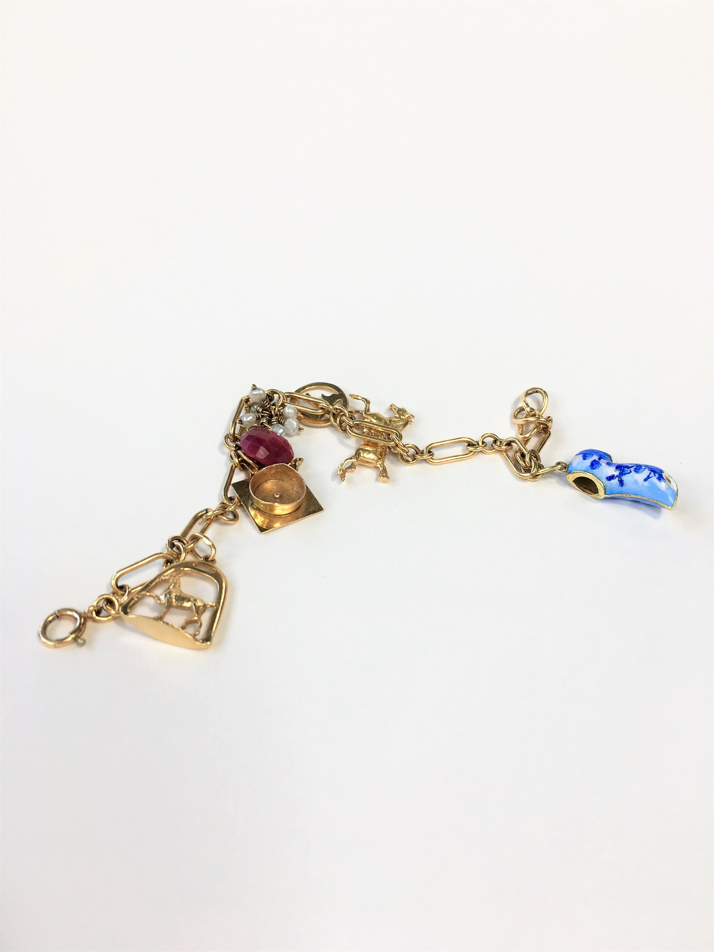 let me make you a custom charm bracelet using vintage charms. I'll take your interests and make a beautiful heirloom piece.