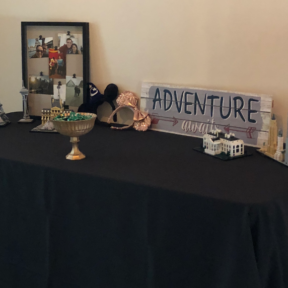 Anthony took the time to give me a tour of their wedding. He and Lynn love to travel together and on this table they share about some of their favorite trips.