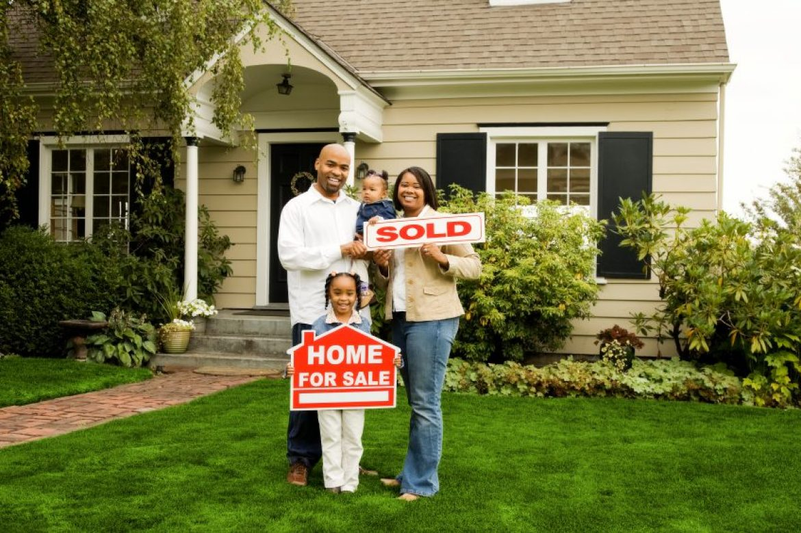 family_with_sold_home-1170x0-c-center.jpg
