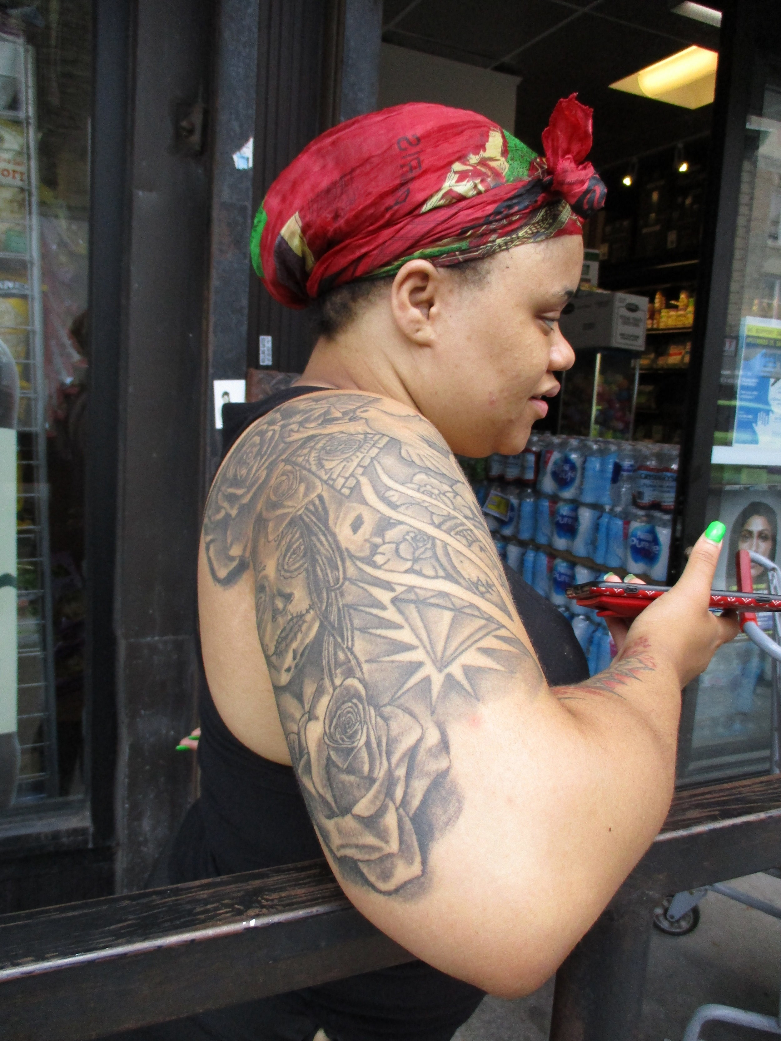 """A young lady outside Met Food says, """"I like tattoos, and I do whatever I want."""""""