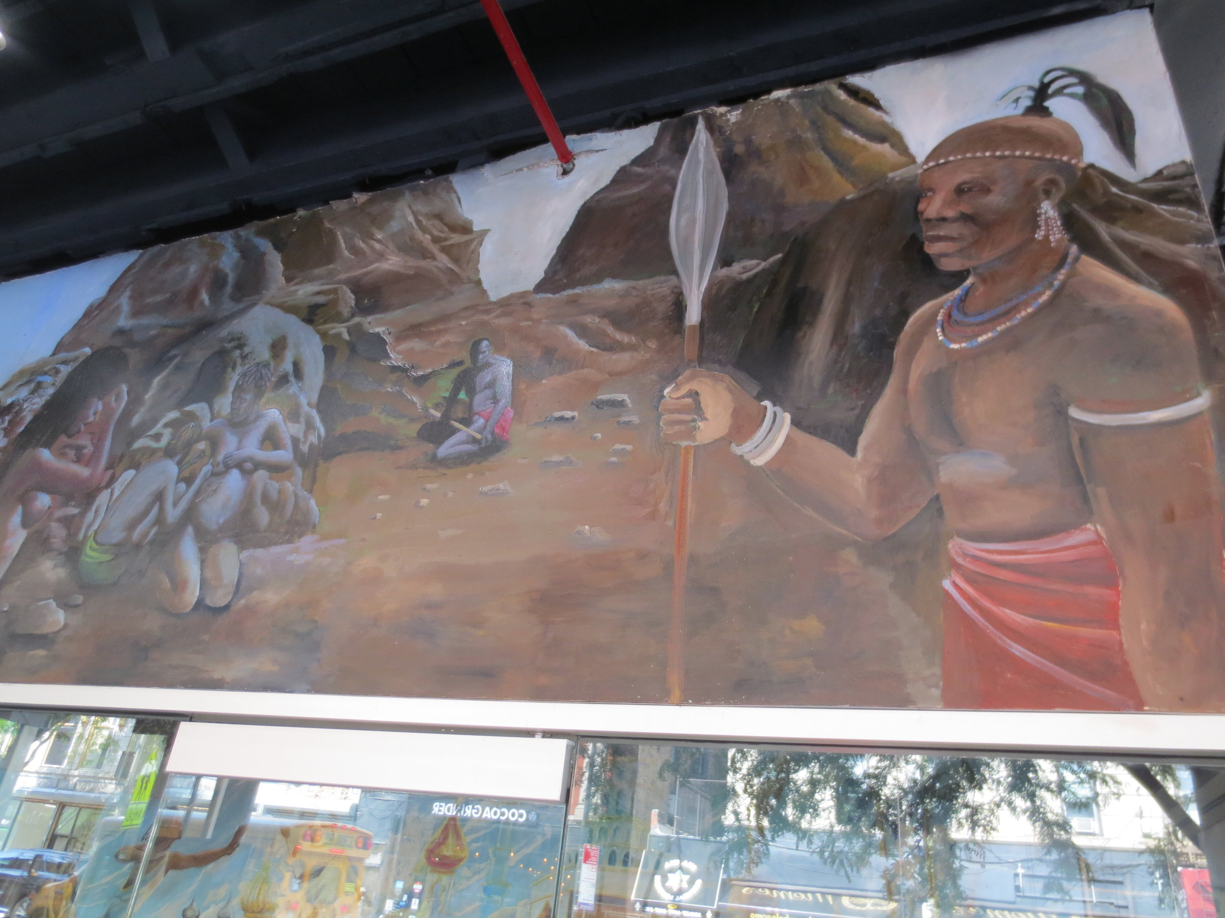 A mural at The Black Lady Theatre depicting Black History from prehistoric times to the present.