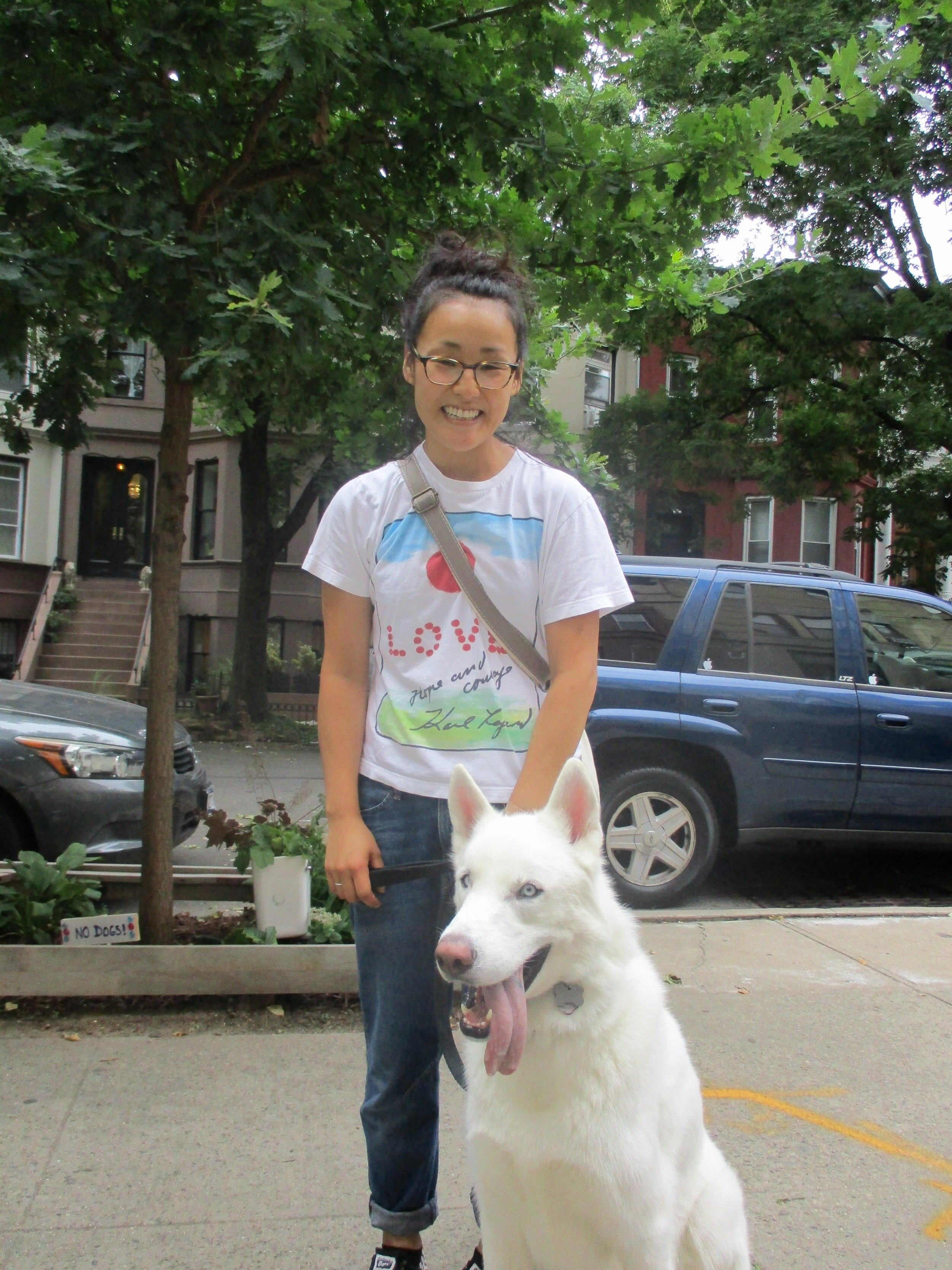 Yuri with her white Husky on Lincoln Place