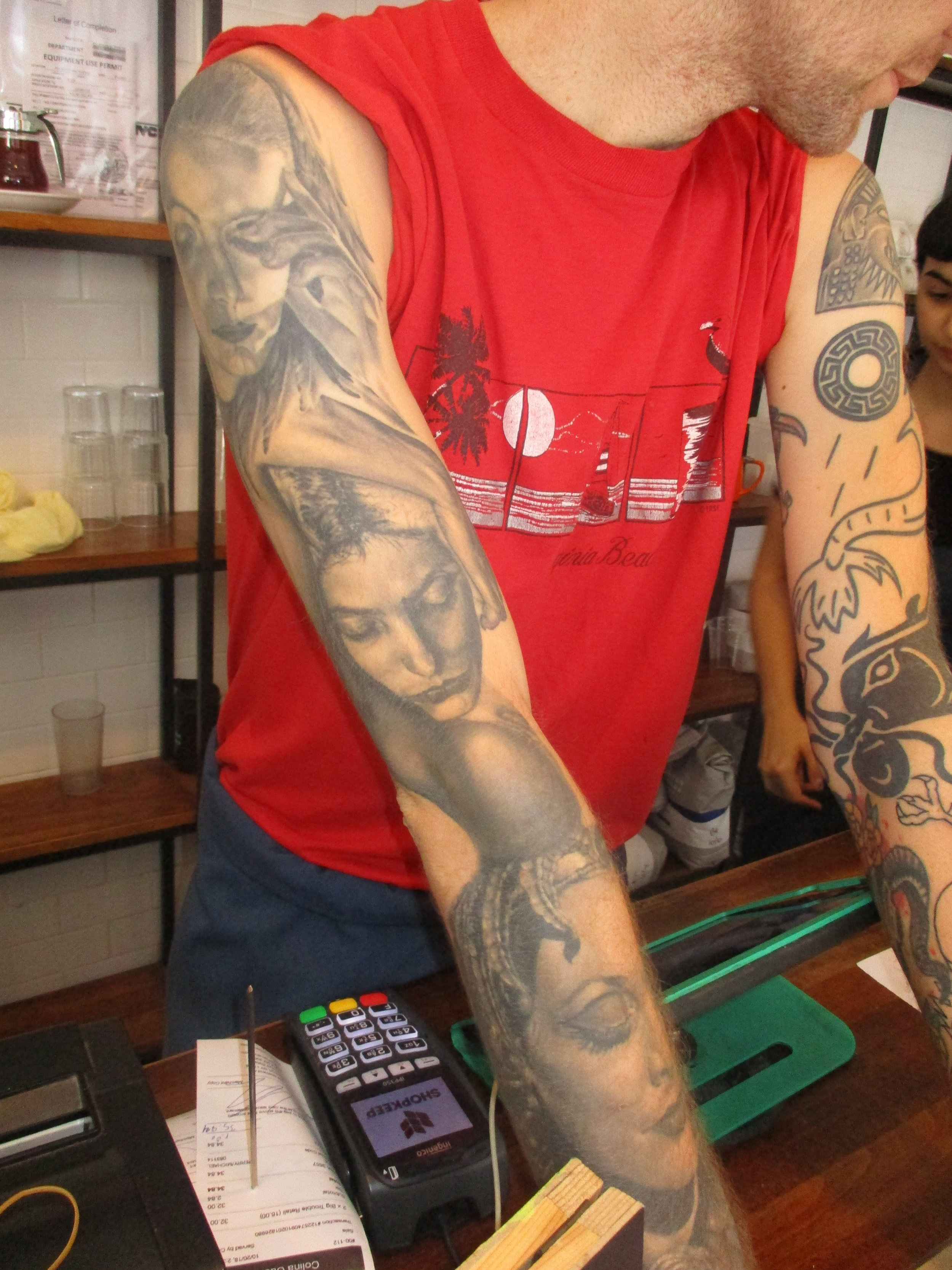 New worker at Colina Cuervo right arm pictures of beautiful women. Some representing past relationships.