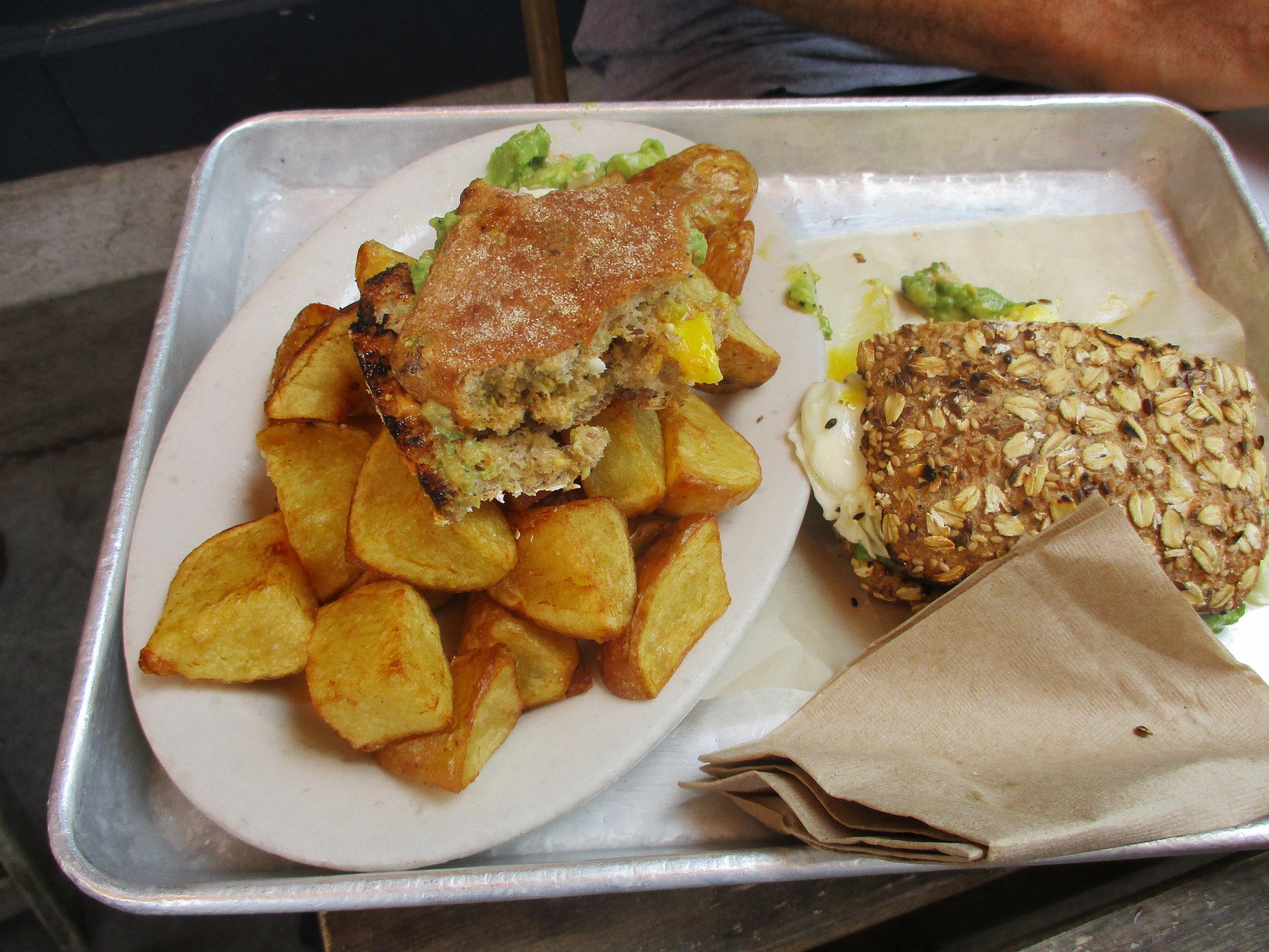 Famous chicken sandwich half eaten on potatos at Lincoln Station