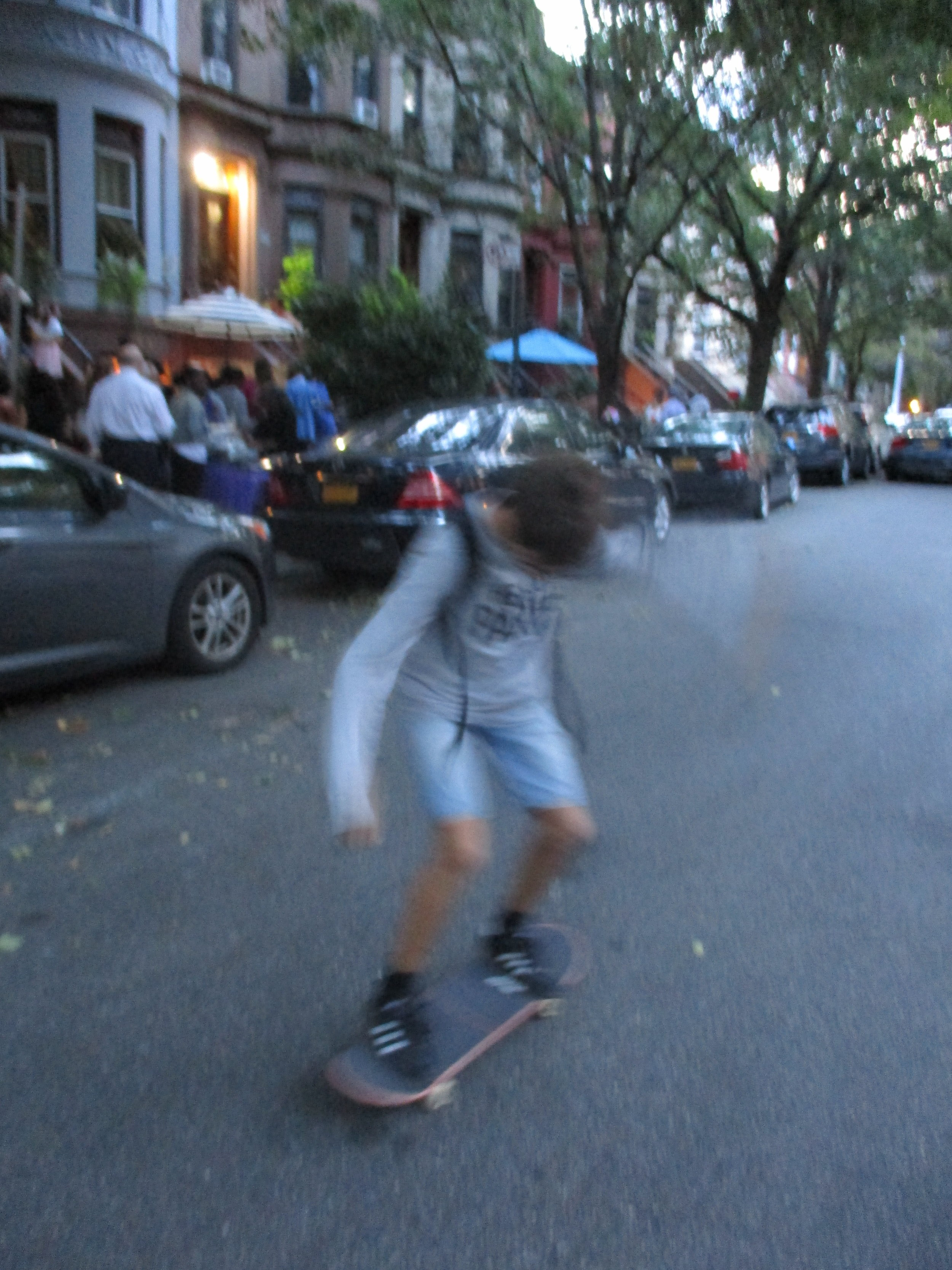 Successful landing after a jump on a skateboard on Lincoln Place