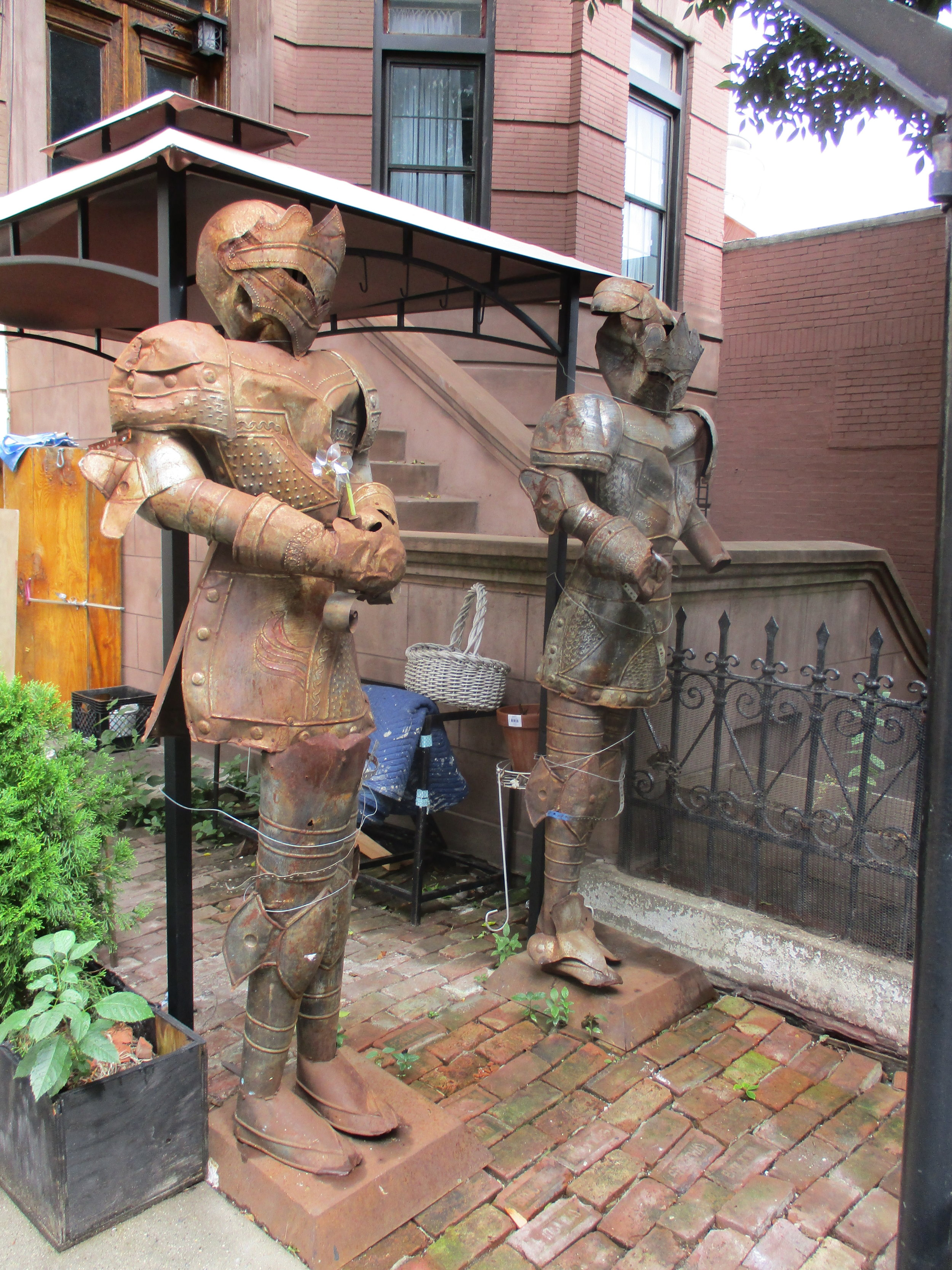 Two knights guarding a real estate establishment