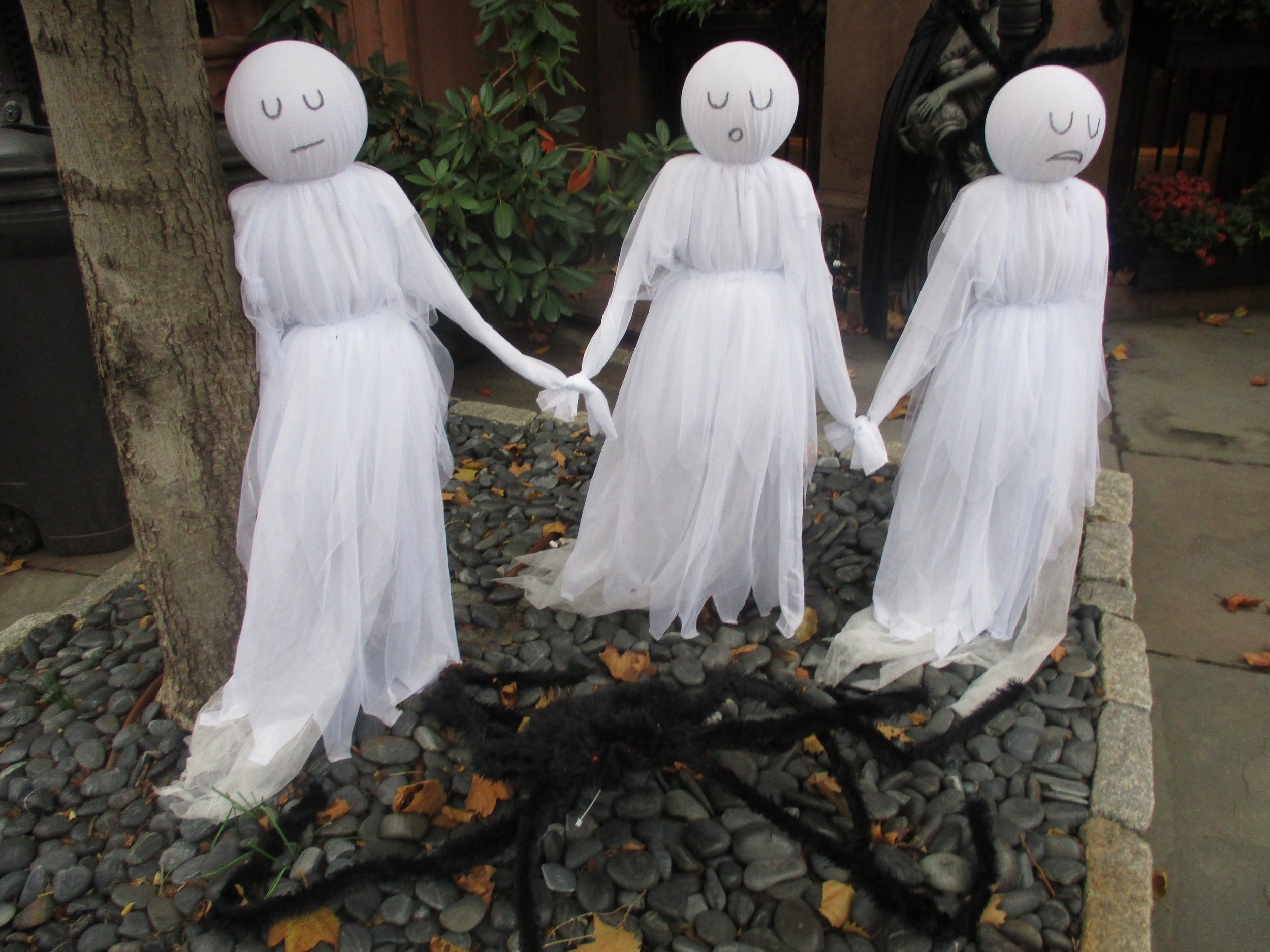 Three ghostly sisters with black spider