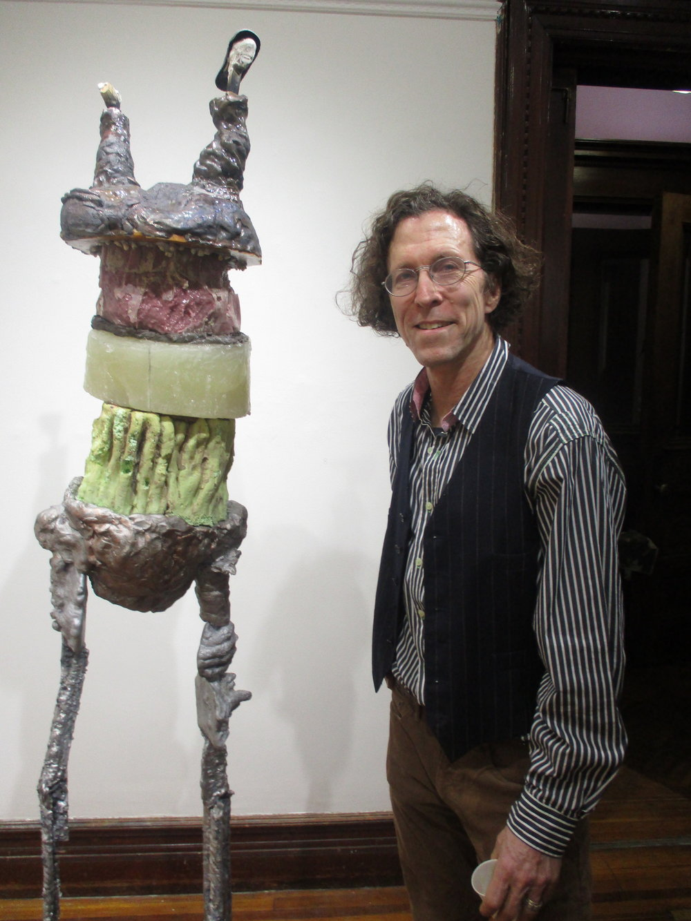 "Don Doe standing with sculpture ""Study for Brother"""