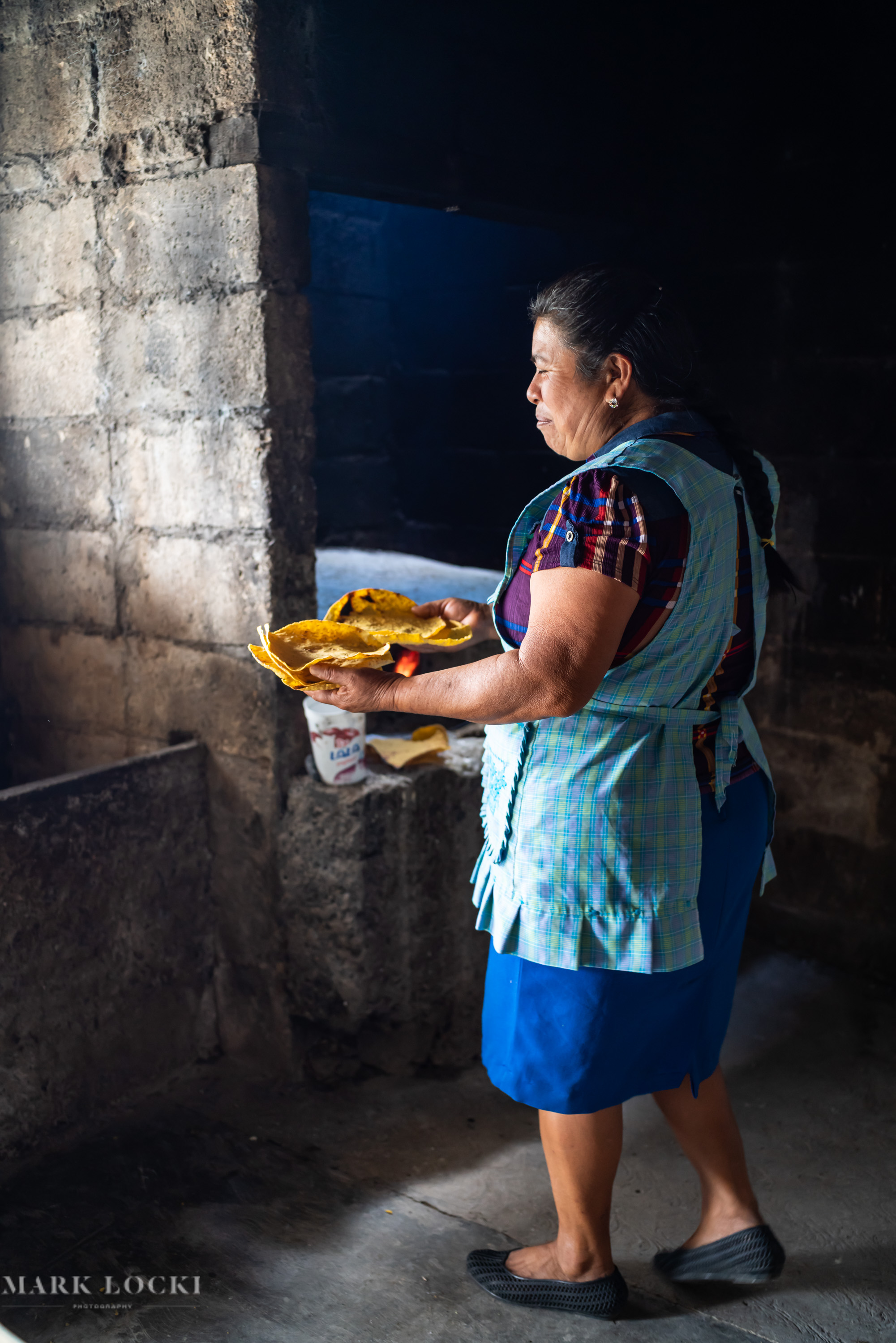 A lady makes Tostadas with the corn from their fields - Yaluma, Chiapas, Mexico
