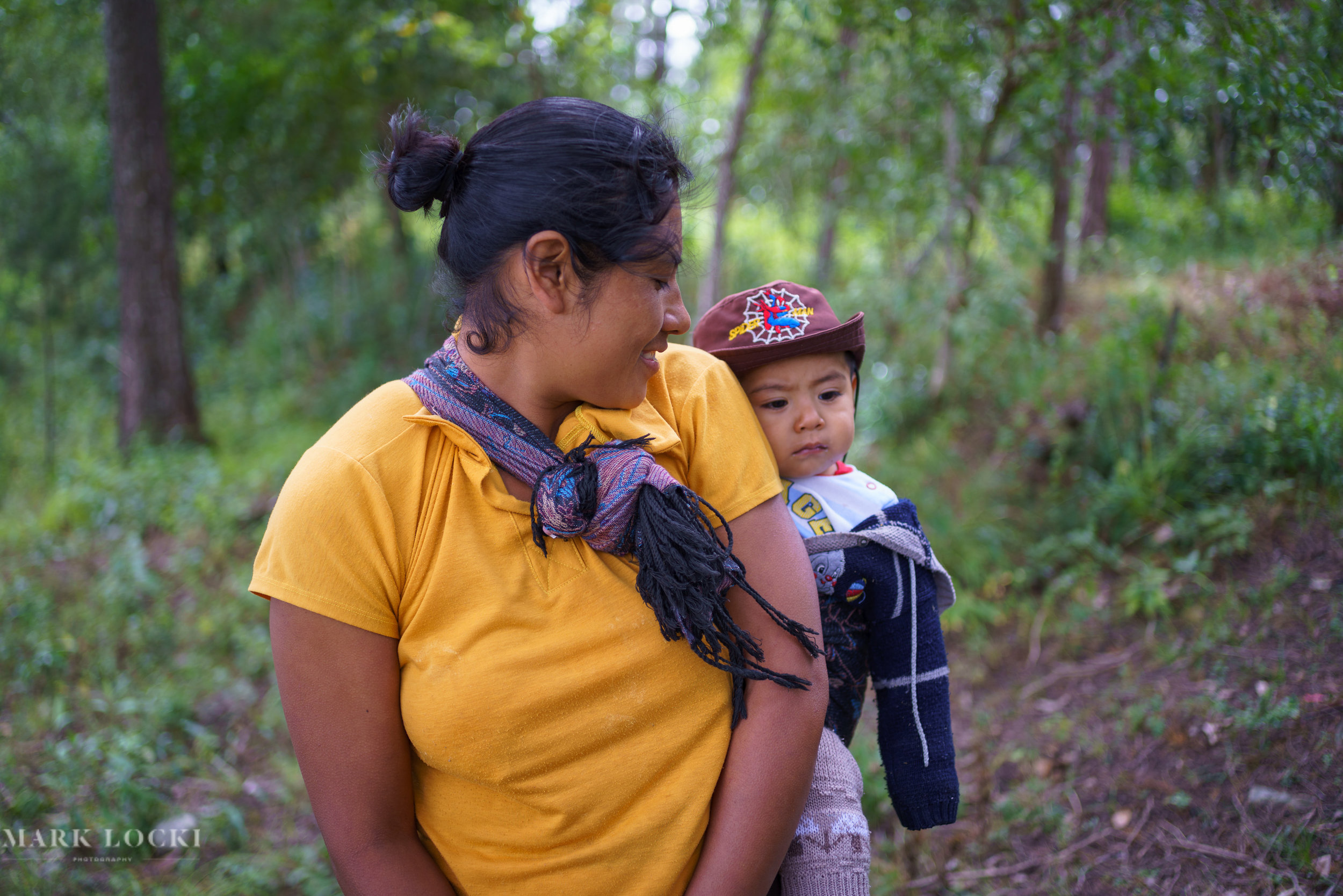 A young woman with her son in the forests of Yaluma, Chiapas, Mexico.  The forest was planted with the help of Cooperativa AMBIO, a Mexican NGO operating in Chiapas