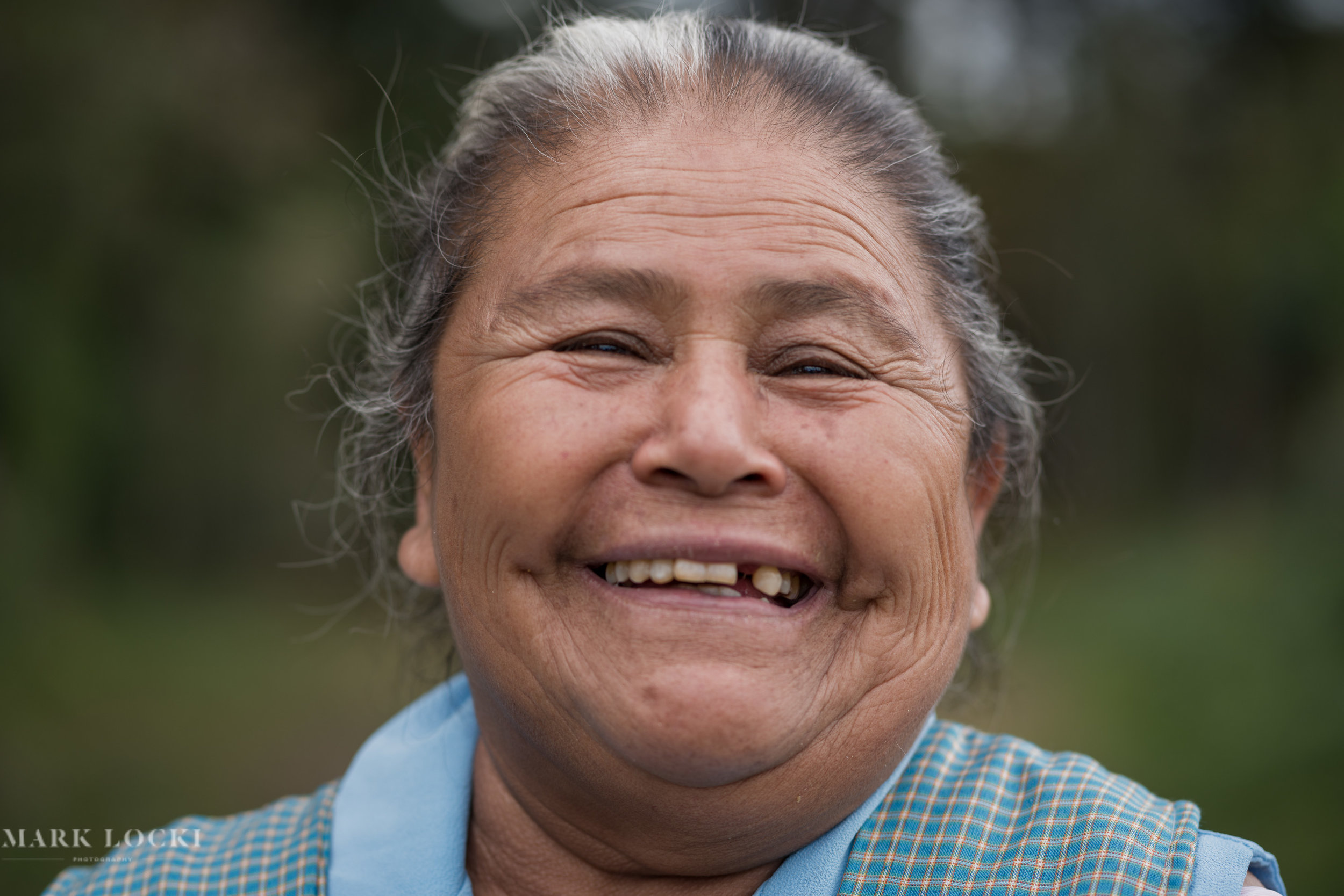 A woman from Yaluma is all smiles as we discuss what benefits she receives from the forests in her hometown.