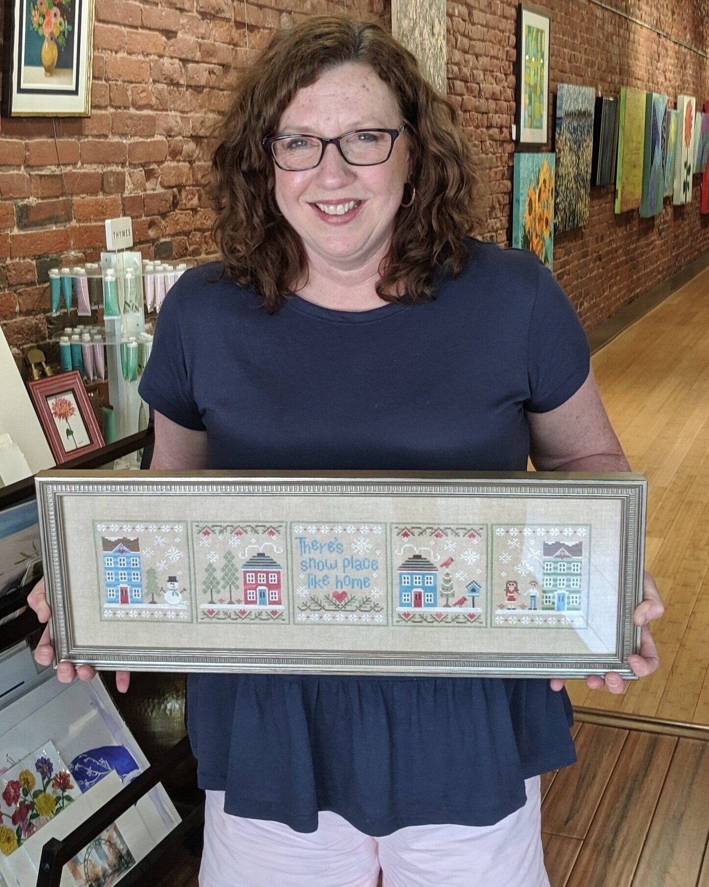 "Michele Denny - What's your framing story?""I love to stitch!""What should others know about Rumjahn Custom Framing?""The Rumjahn Gallery continues to offer the same quality I enjoyed when they were Riverwind."""