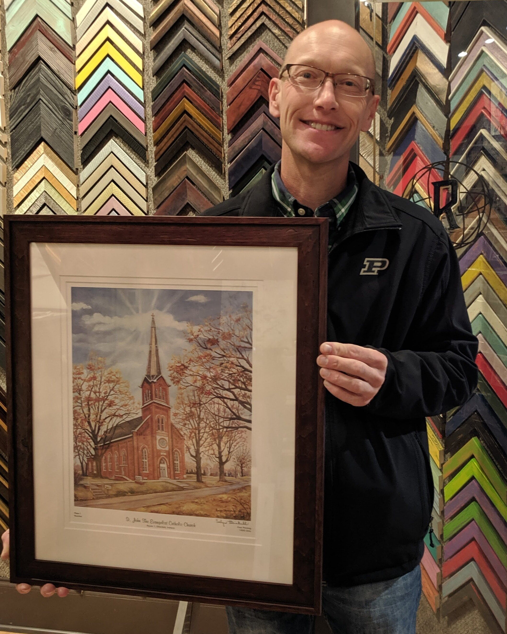 "Brian & Melissa Fox - Tell me a little bit about this project.""This is a print of St. John Daylight Catholic Church. There is a lot of family history at the church. Grandparents, parents married there. Special family significance. Our kids are 4th generation.""What should potential customers know about The Rumjahn Framery?""Absolutely wonderful, fantastic. Great to work with, very helpful."""