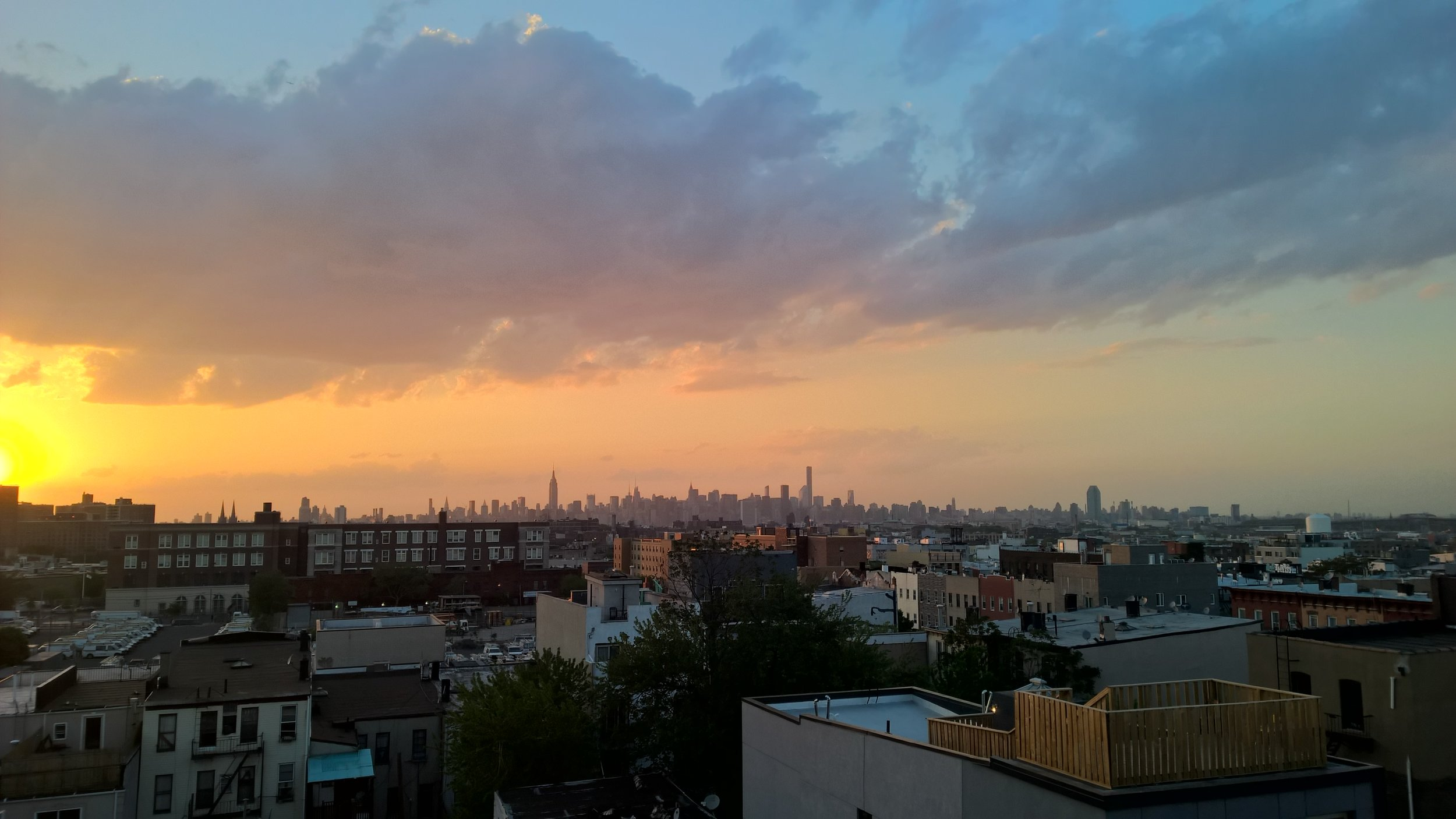 new york city at night - views from penthouse roof deck during sunset