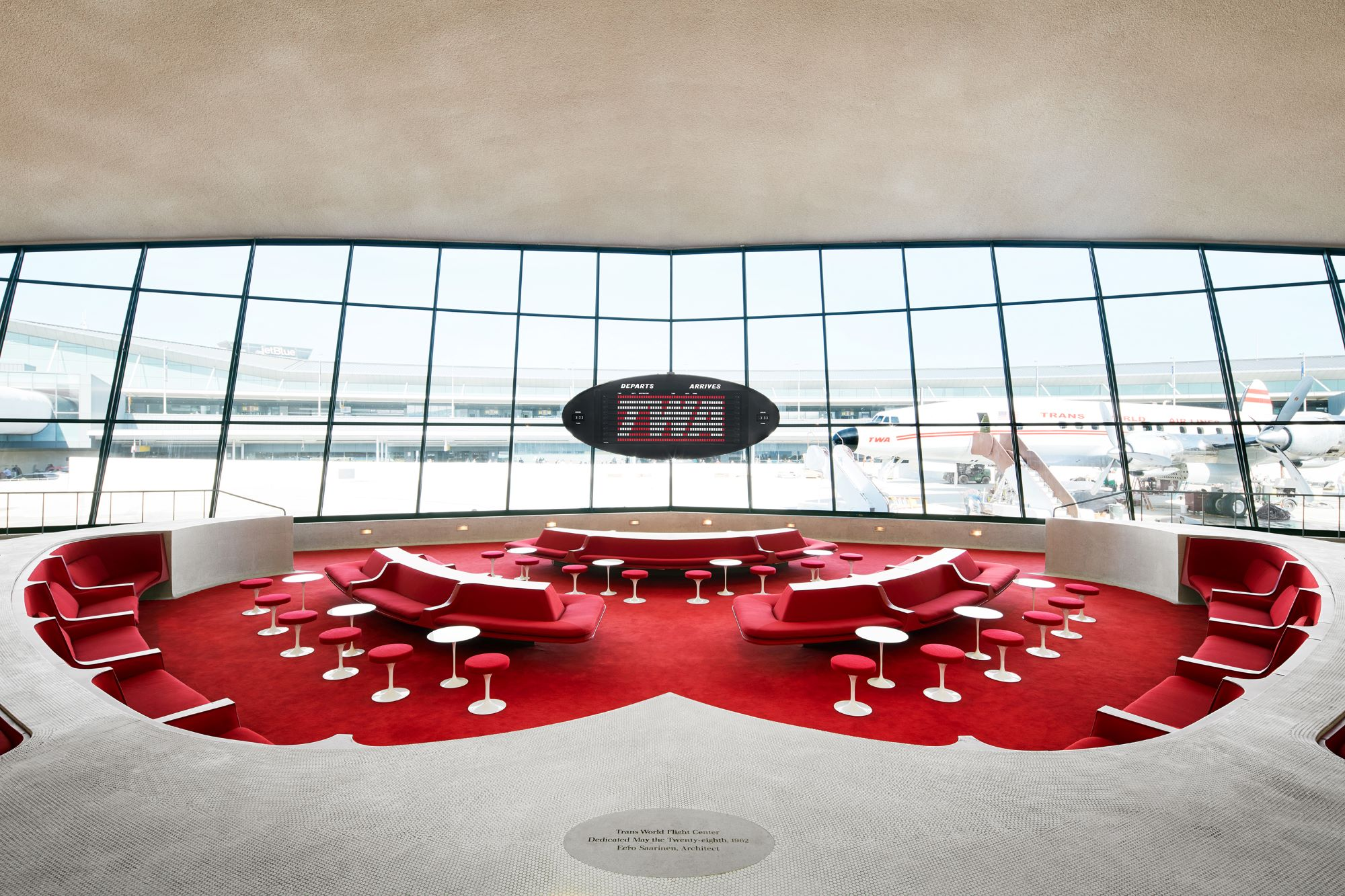 The sunken lounge with iconic TWA red carpet and seat coverings