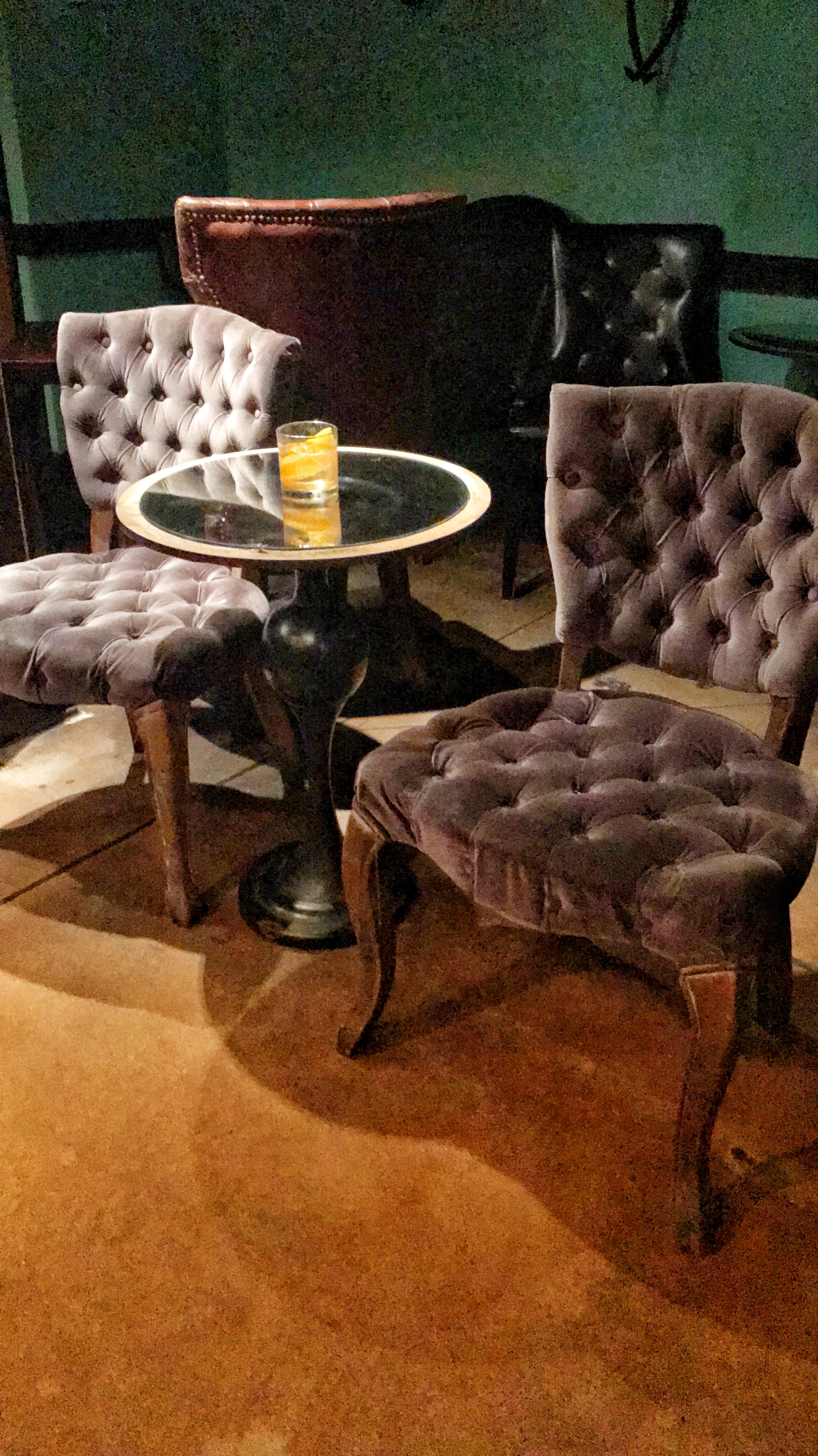 The main bar is surrounded by quaint,stylish chairs and tables that resemble the ambience of the late 1800s. -