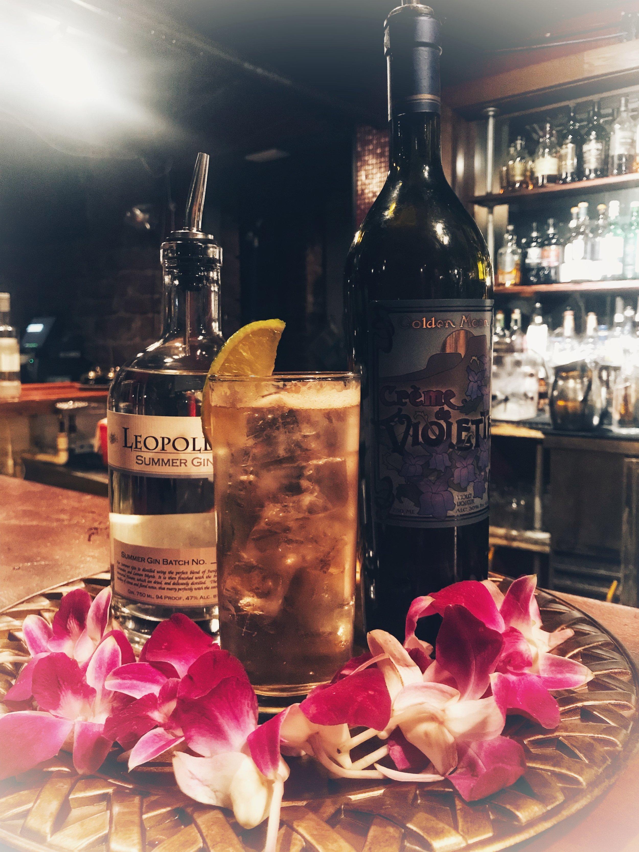 Leopold's Summer Gin (1.5 oz)  Golden Moon Creme de Violette Liqueur  Tonic Water  Lime