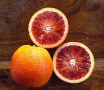 Moro Blood Orange - Moro Blood Oranges are the best of the pigmented oranges for our climate. The pigments of the fruit flesh is more subtle when grown in Hawaii because there is less variation between our day and night temperatures. They are a very prolific producer of juicy sweet seedless fruit.