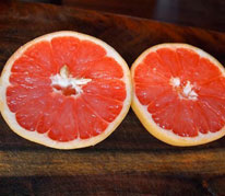 Star Ruby Supreme Grapefruit - Is the best all around pink grapefruit for Hawaii. The fruit is seedless, thin skinned, and delicious with no bitter aftertaste. The color is excellent and the high quality fruit lives up to its name. The trees will grow into a large, dark green canopy, so it is best to prune the tree regularly for ease of harvest.