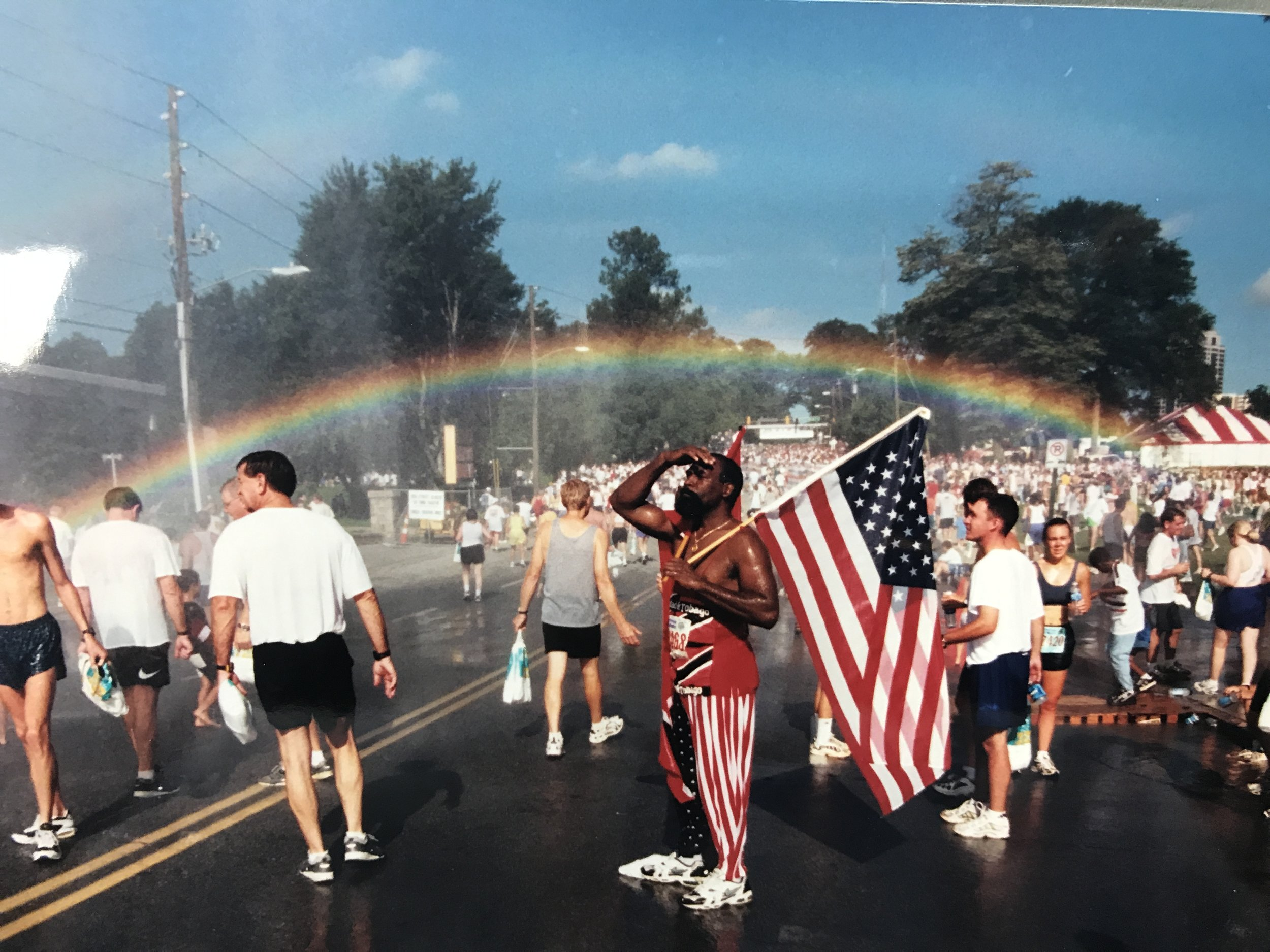 A rainbow perfectly arches over 10th Street in 1999, the first year the race finished there.