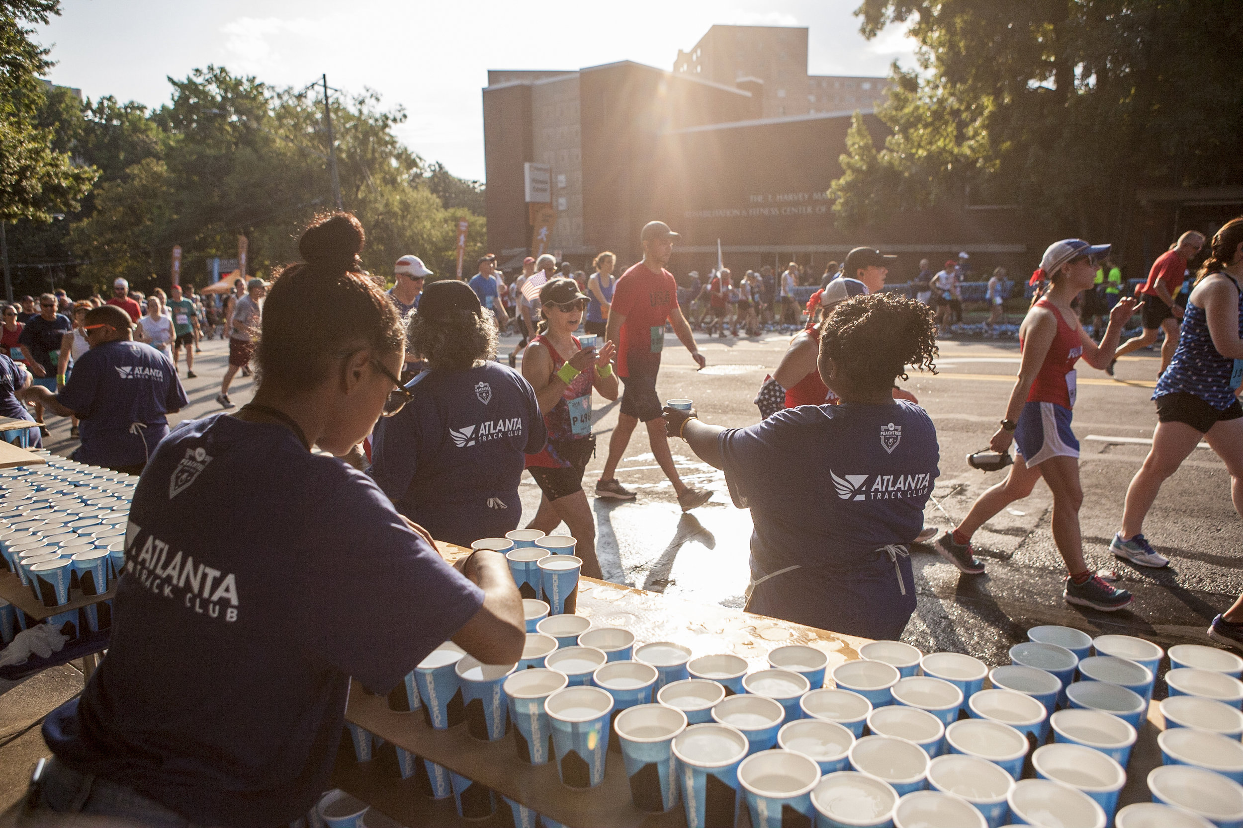 Volunteers handing out water over the years