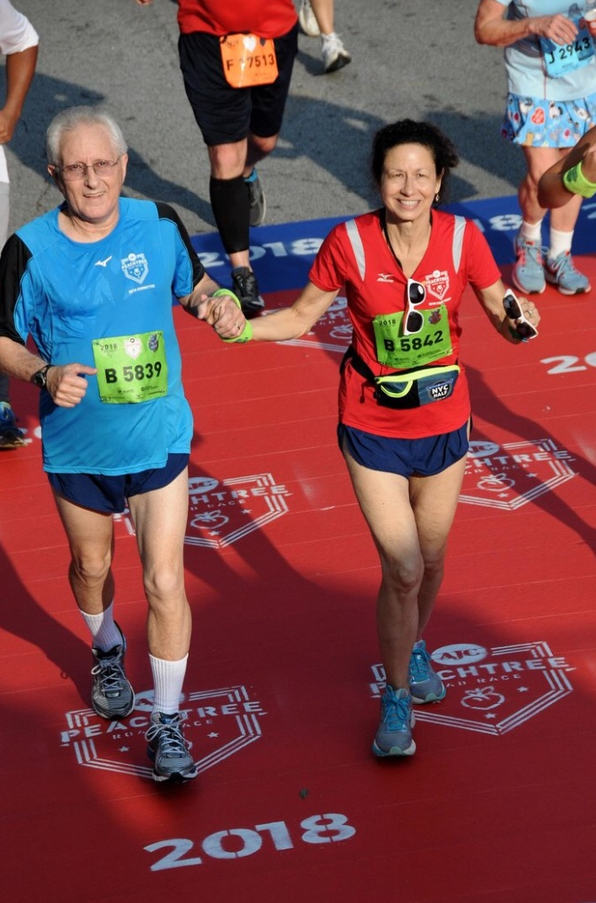 Jack and Sandra Abbott crossing the finish line