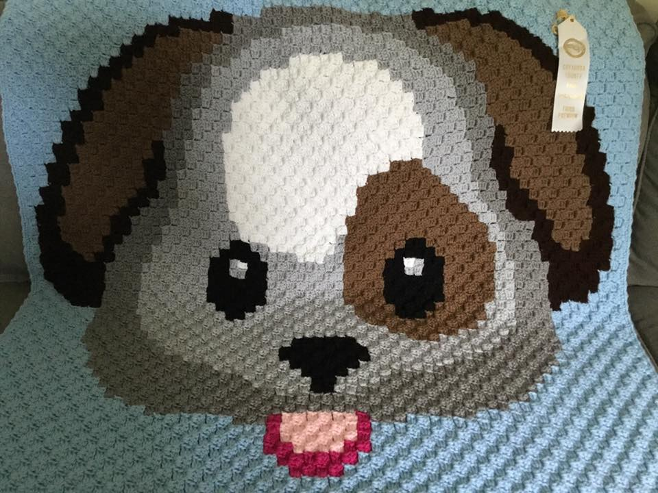 Puppy Face Baby Afghan - by Sue Lemal earns a 3rd place white ribbon - 2019