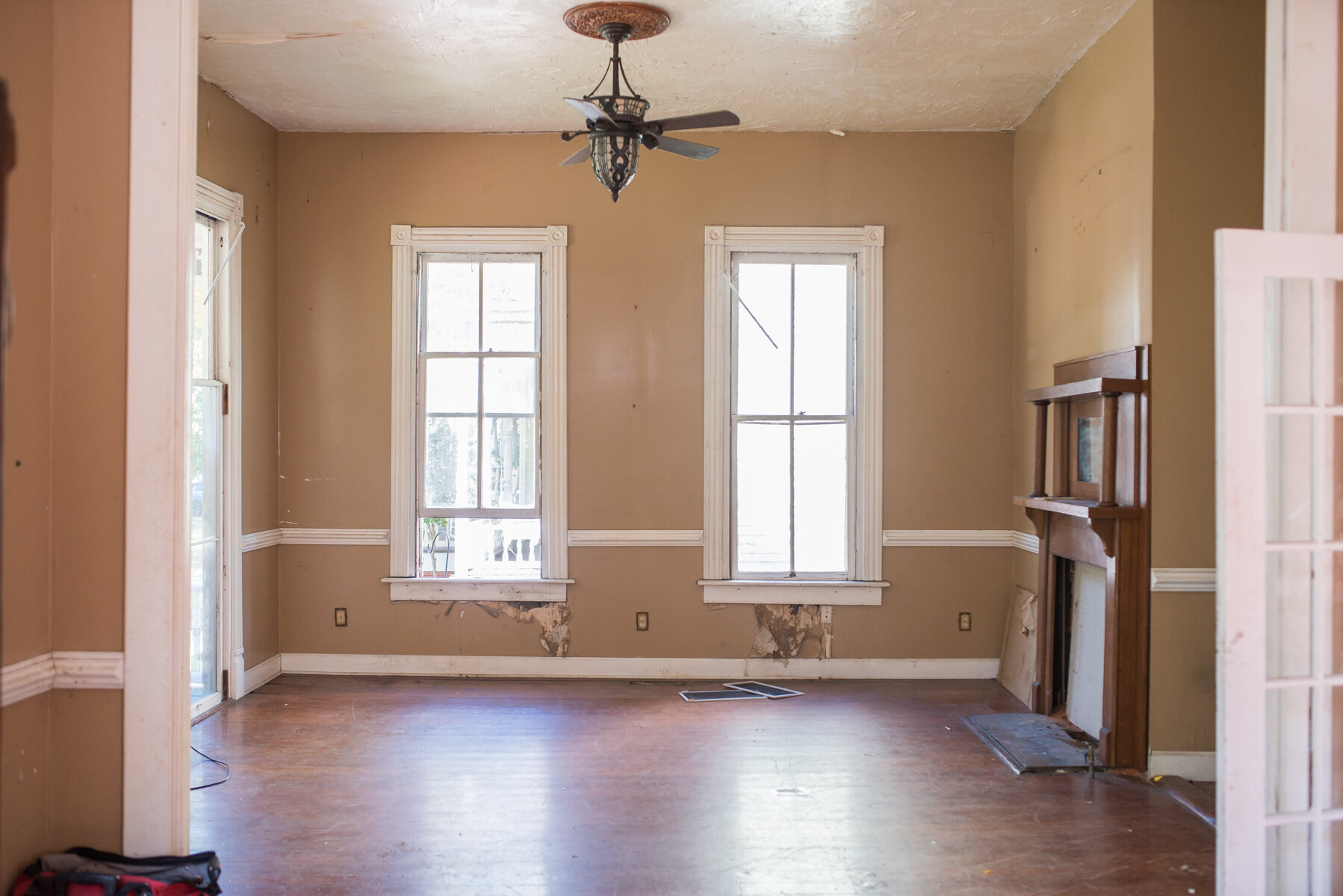This is the room directly to the left when you walk in. We'll replace this opening with the original wall that was there, with french doors and a transom above. We'll use this as the playroom until the kids are older, when it will become more of a formal living space.