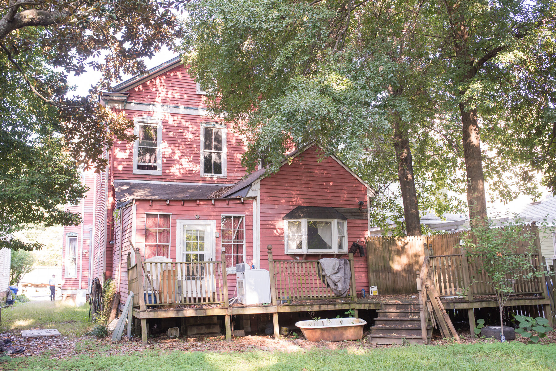 This is the back of the house. The porch has already been removed, as well as the roof and siding of the addition.