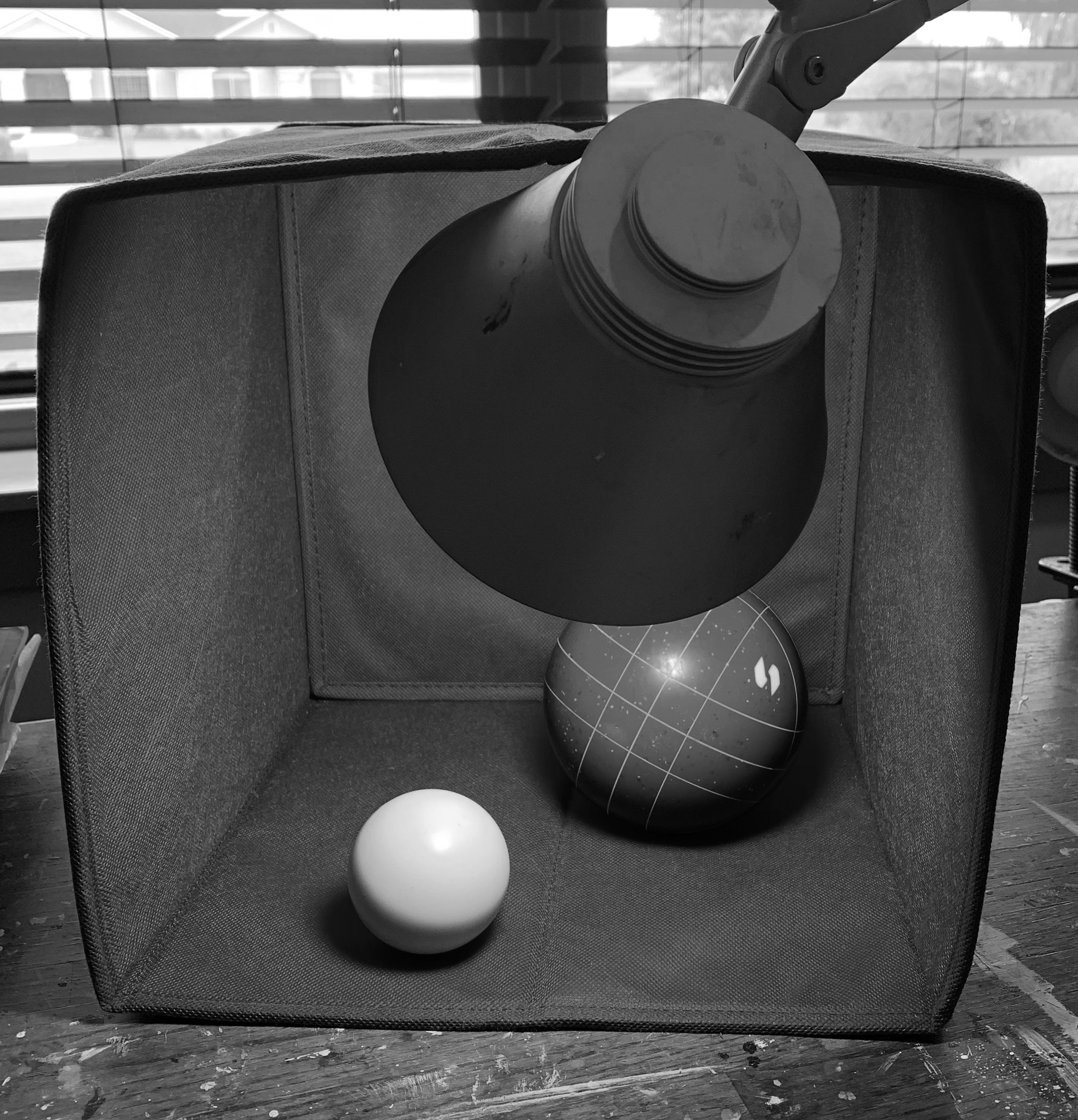 balls in a box with shadows.