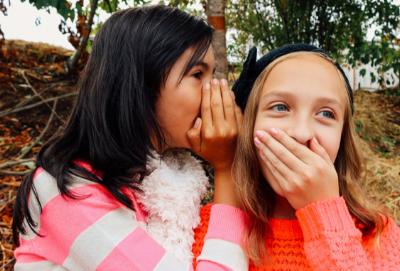 girls whispering blog.png
