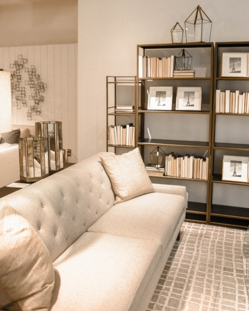 A living room with a creamy white as its anchor color.