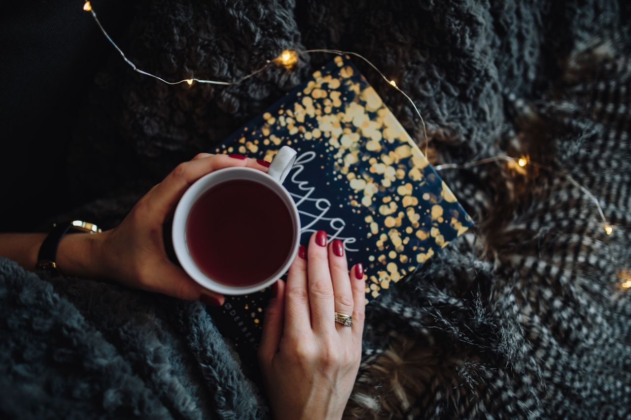 kaboompics_Young woman at home reading Hygge book and drinking tea.jpg