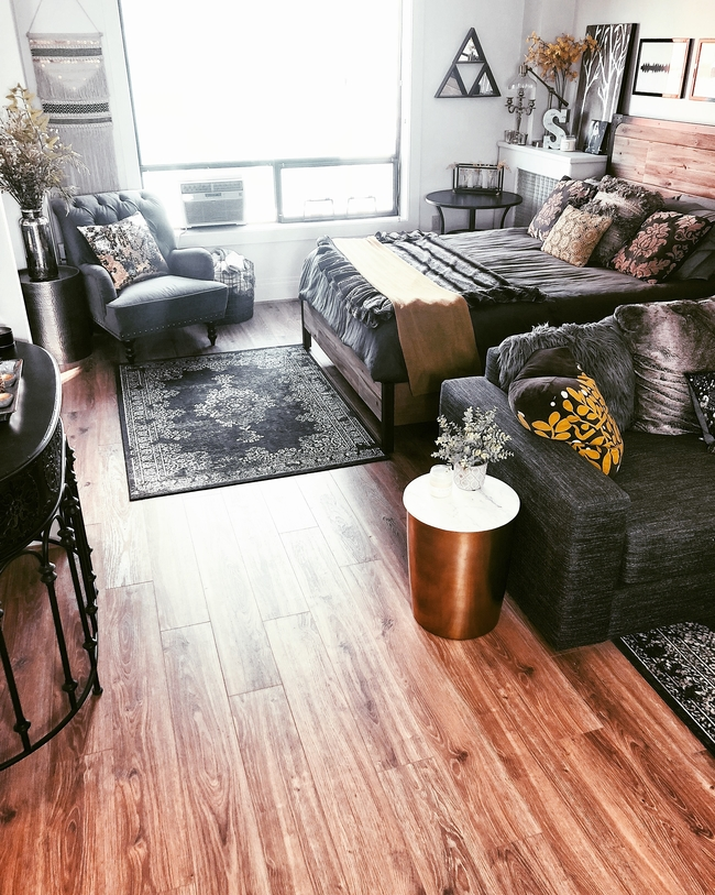 Studio apartment decorating on a budget with rustic home styling.